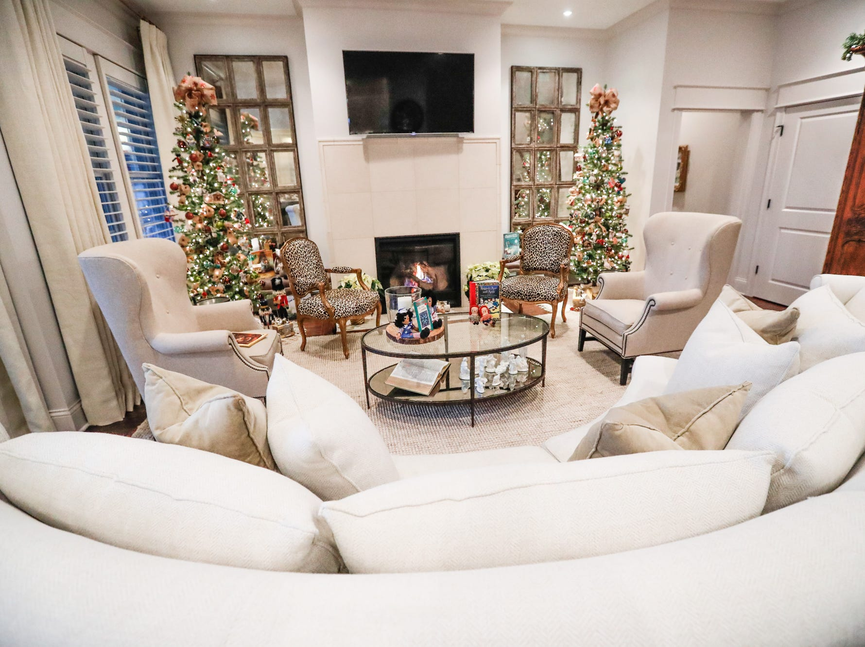 The contemporary plantation-style home belonging to Lezlie and Terry Heath features a living room decorated with Raggedy Ann and Andy during the Carmel Clay Historical Society Holiday Home Tour in Carmel Ind. on Saturday, Dec.1, 2018. The couples son, Craig Heath, helped to design the home.