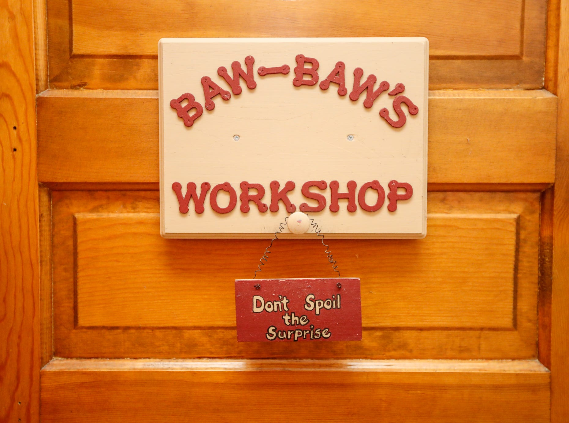 A sign welcomes family to Baw-Baw's Workshop in the 1903 home belonging to Ruth and Russell Schwartz features original wood and builtins, during the Carmel Clay Historical Society Holiday Home Tour in Carmel Ind. on Saturday, Dec.1, 2018.