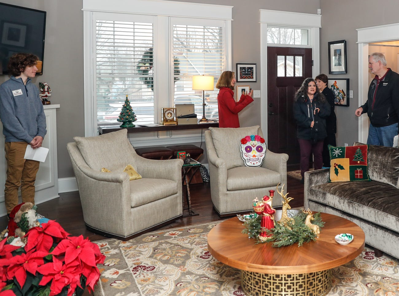 Guests tour the home of Brad Sexauer during the Carmel Clay Historical Society Holiday Home Tour in Carmel Ind. on Saturday, Dec.1, 2018. The home features an array of fine art, and an open concept floor plan.