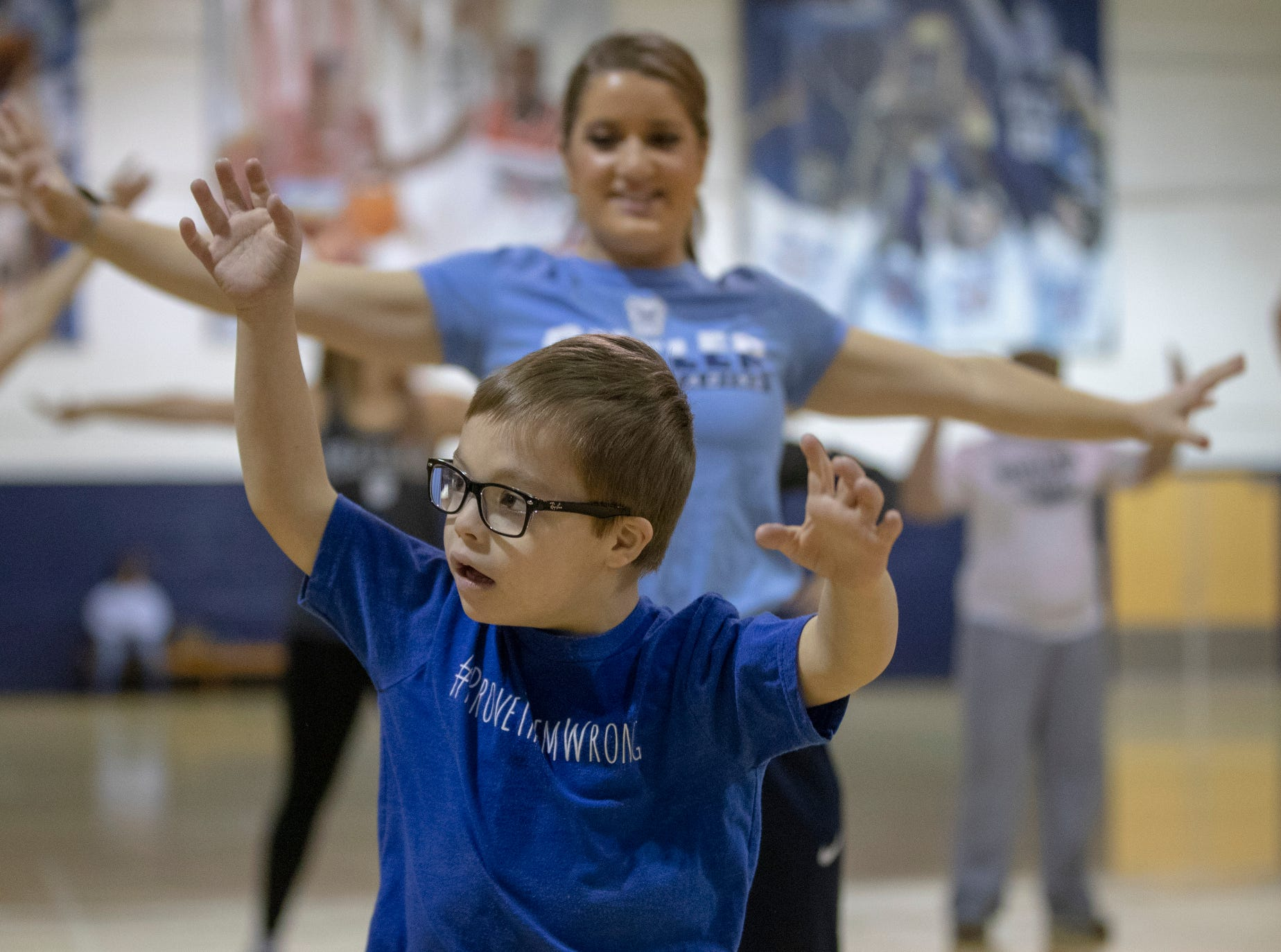 Will Meehan, 6, Fishers, learns a special halftime performance before the Butler women's basketball game at Hinkle Fieldhouse, Indianapolis, Sunday, Dec. 2, 2018. Butler cheer and dance groups paired up with physical therapy students from Indiana University to teach young people with special needs a routine in preparation for the performance.