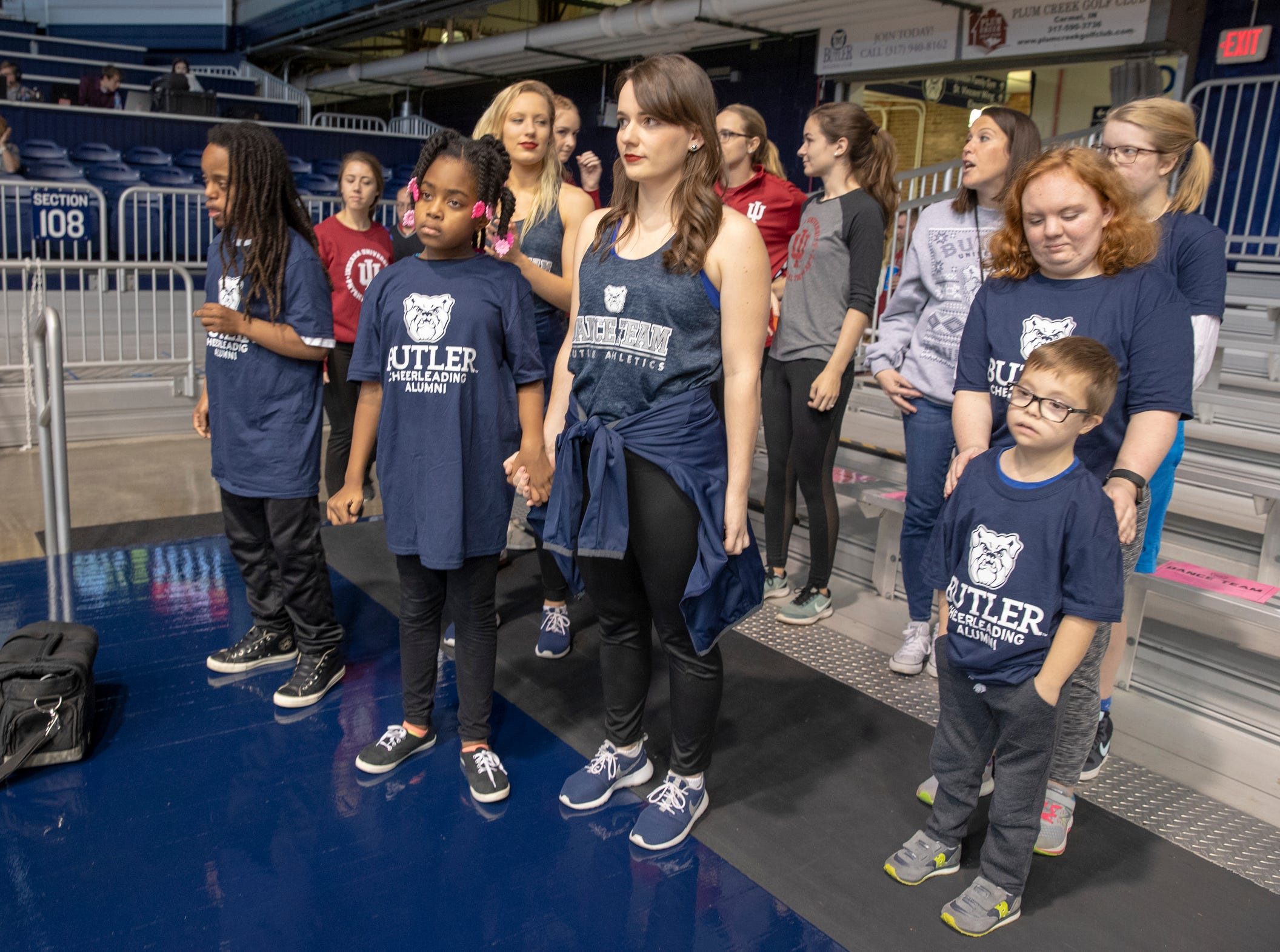 Students wait to take the floor for a special halftime performance during the Butler women's basketball game at Hinkle Fieldhouse, Indianapolis, Sunday, Dec. 2, 2018. Butler cheer and dance groups paired up with physical therapy students from Indiana University to teach young people with special needs a routine in preparation for a special performance during the afternoon's halftime show.