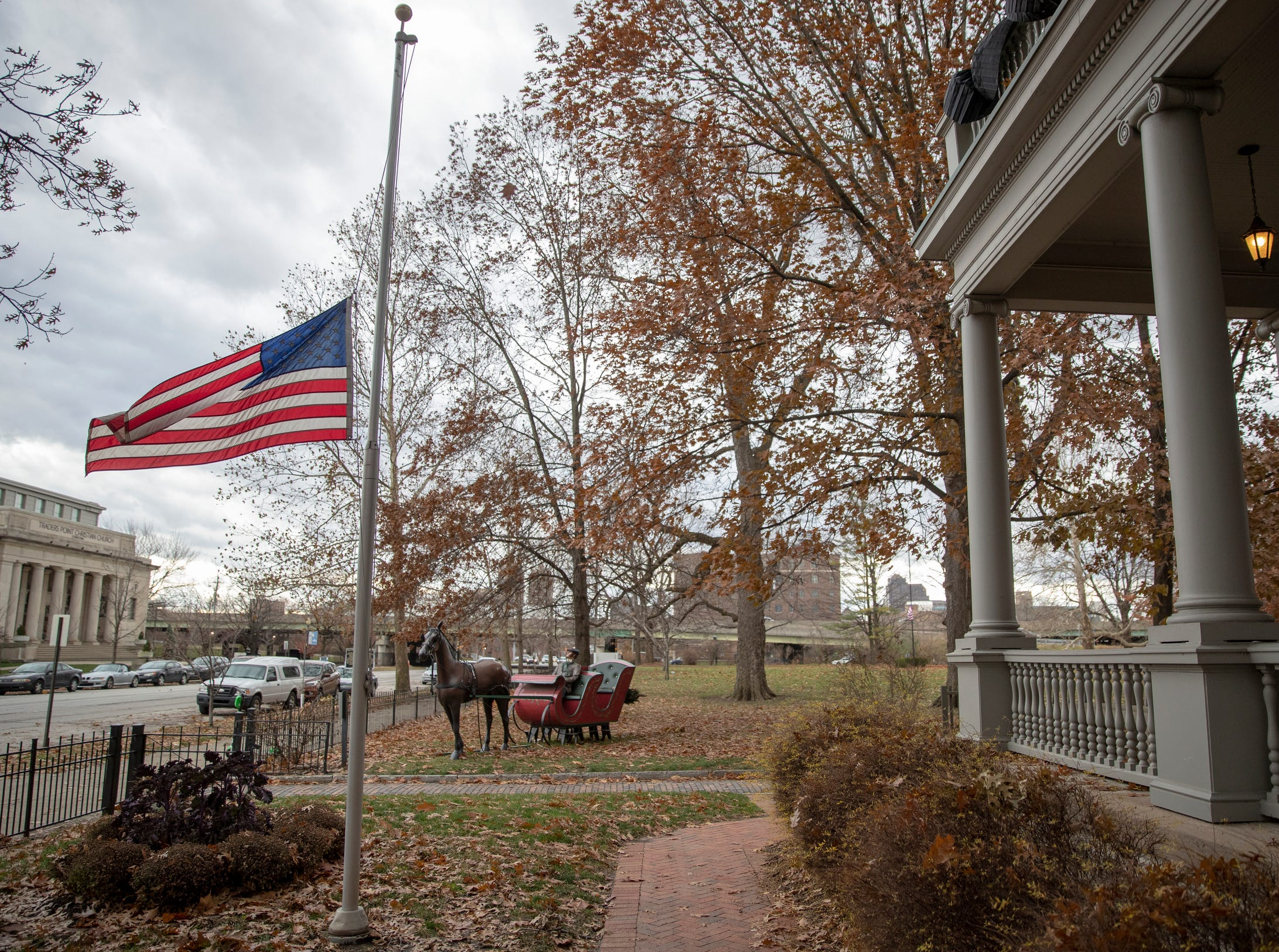 A flag at half mast at the Benjamin Harrison Presidential Site, Indianapolis, Sunday, Dec. 2, 2018. This flag, and nearby mourning bunting, pay respects to George H. W. Bush, the 41st President, who died on Friday evening in Houston.