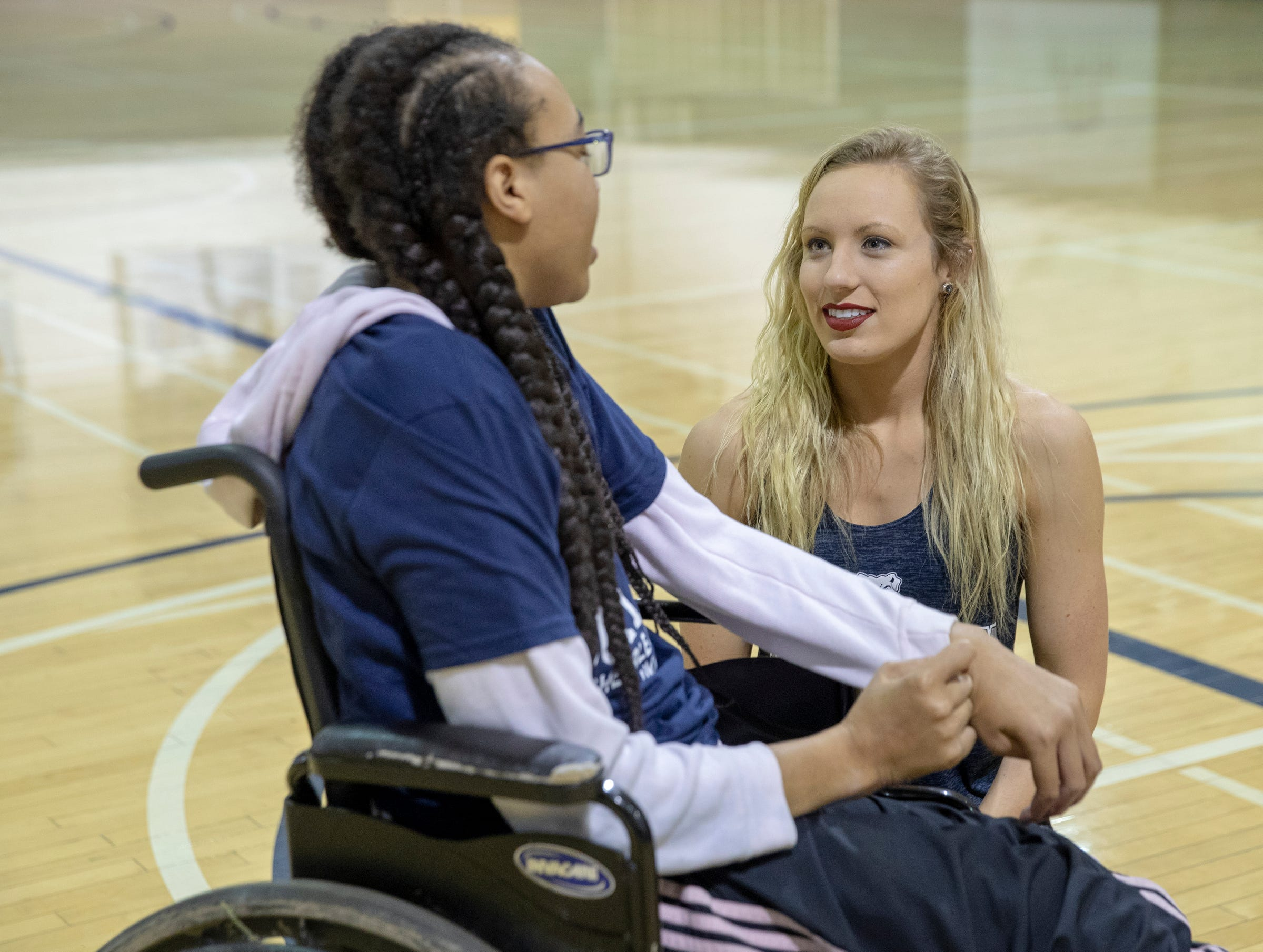 Kiara Lee (left), chats with Riley Banks, 19, a member of the Butler University dance team after learning a special halftime performance during the Butler women's basketball game at Hinkle Fieldhouse, Indianapolis, Sunday, Dec. 2, 2018. Butler cheer and dance groups paired up with physical therapy students from Indiana University to teach young people with special needs a routine in preparation for a special performance during the afternoon's halftime show.