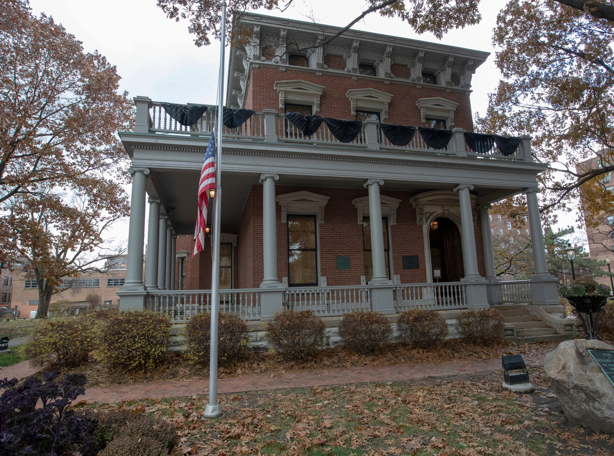 Mourning bunting being installed at the Benjamin Harrison Presidential Site, Indianapolis, Sunday, Dec. 2, 2018. This display, which will cover the railings on top and bottom, and a half-mast flag, pay respects to George H. W. Bush, the 41st President, who died on Friday evening in Houston.