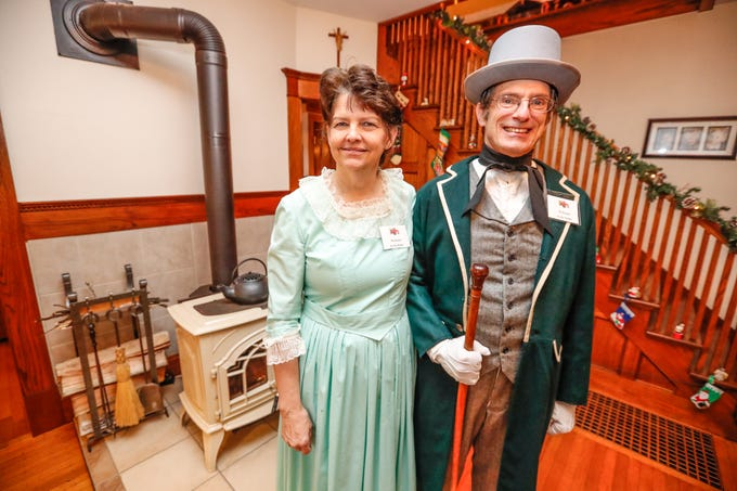 Ruth and Russell Schwartz wear their handmade clothing sewn by Ruth, a seamstress who created the garments for their period wedding during the Carmel Clay Historical Society Holiday Home Tour in Carmel Ind. on Saturday, Dec.1, 2018. The couples 1903 home features mostly original wood and built-ins.