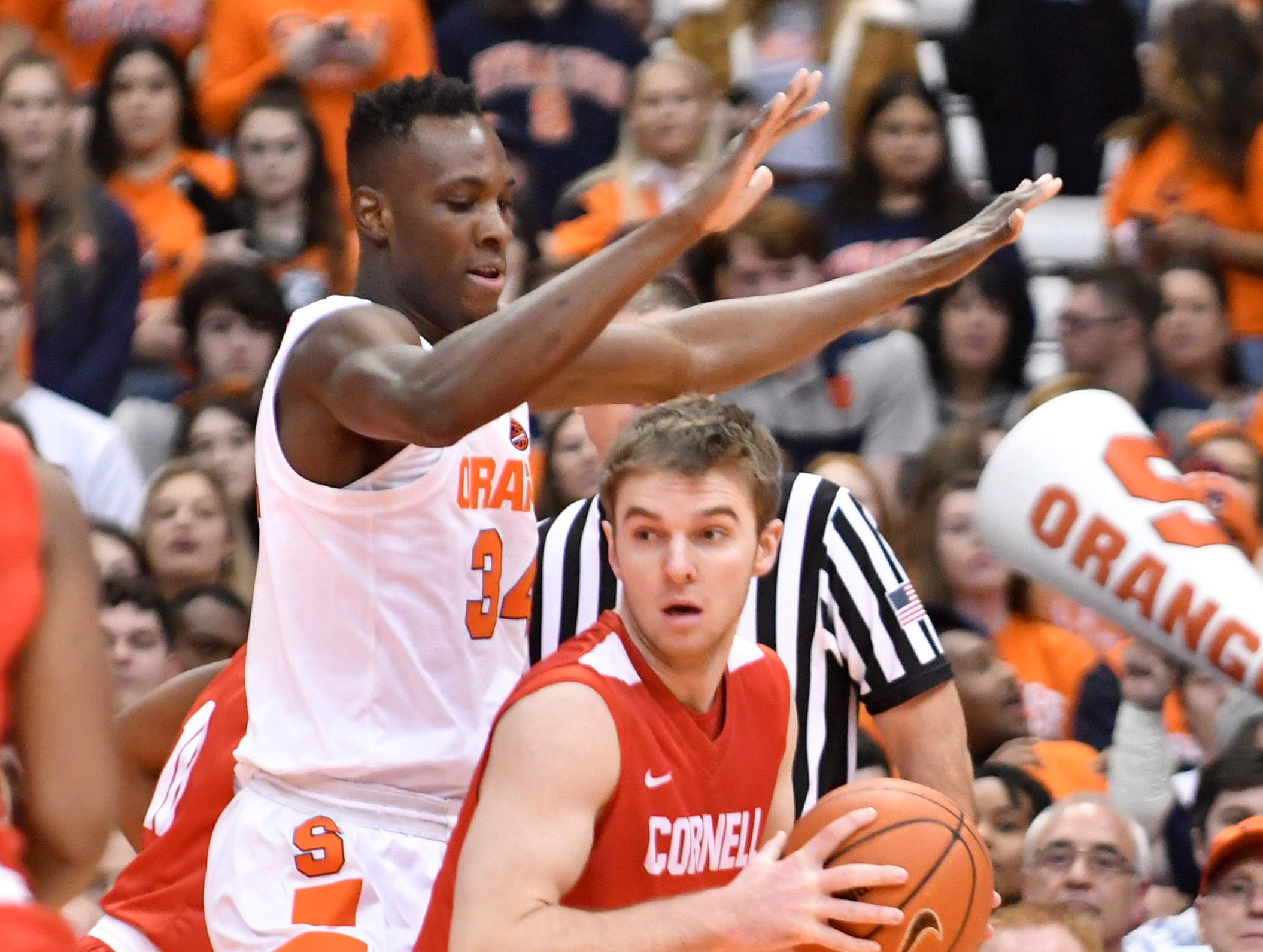 Dec 1, 2018; Syracuse, NY, USA; Cornell Big Red forward Josh Warren (22) is closely guarded by Syracuse Orange forward Bourama Sidibe (34) during the first half at the Carrier Dome. Mandatory Credit: Mark Konezny-USA TODAY Sports