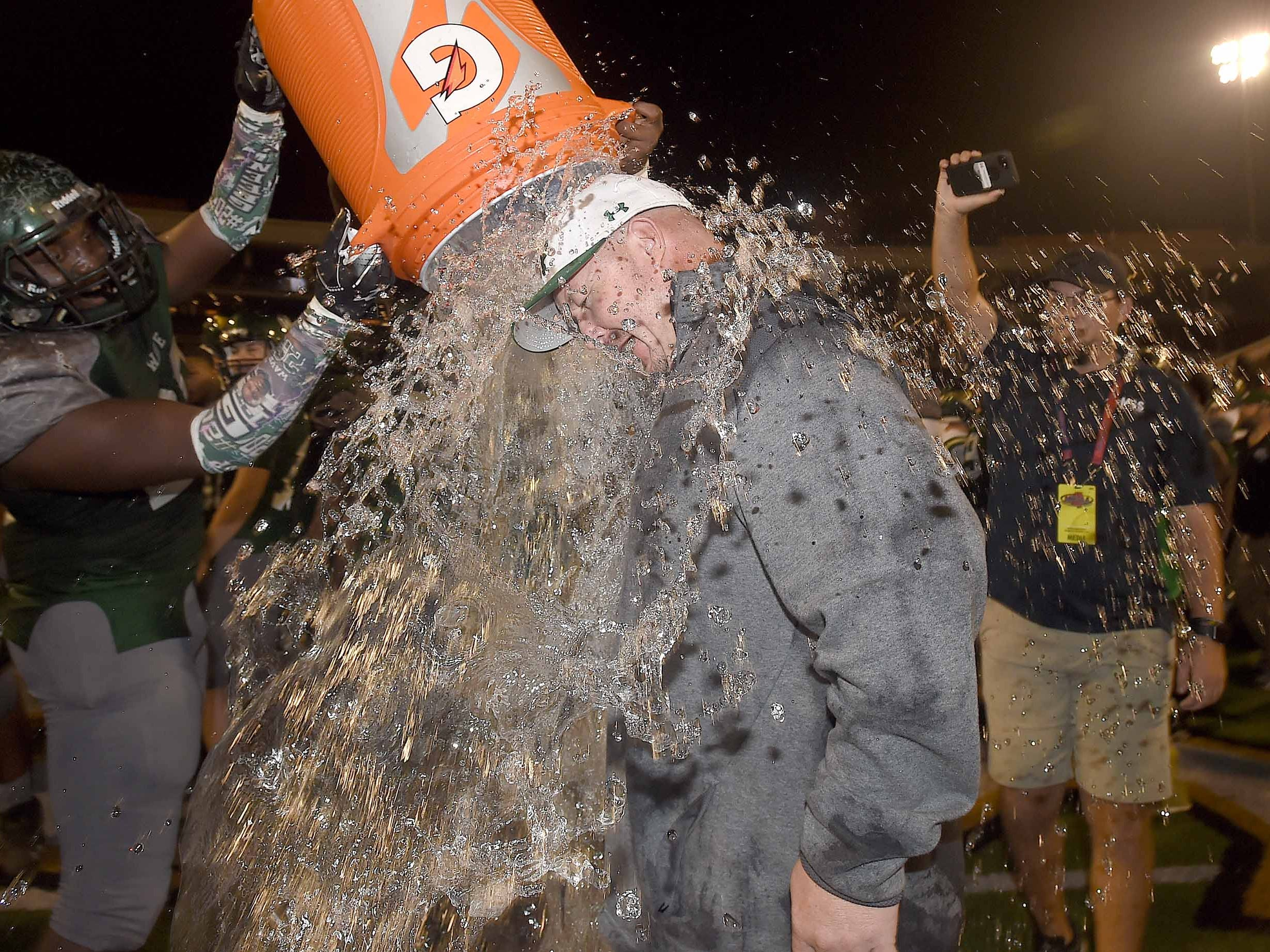 West Point head coach Chris Chambless gets a second ice water bath on Saturday, December 1, 2018, in the MHSAA BlueCross BlueShield Gridiron Classic High School Football Championships in M.M. Roberts Stadium on the University of Southern Mississippi campus in Hattiesburg, Miss.