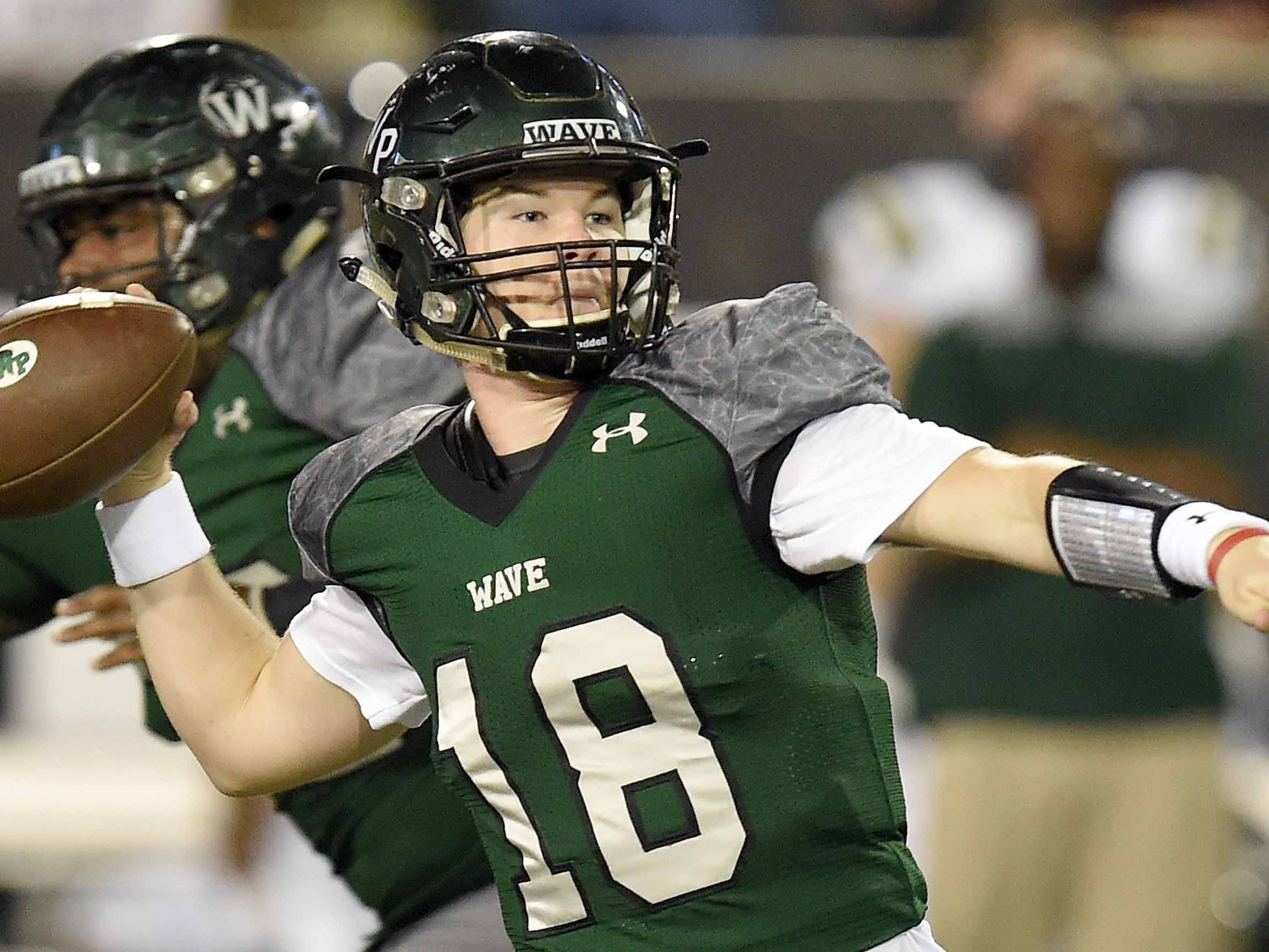 West Point quarterback Jake Chambless (18) throws for a touchdown against West Jones on Saturday, December 1, 2018, in the MHSAA BlueCross BlueShield Gridiron Classic High School Football Championships in M.M. Roberts Stadium on the University of Southern Mississippi campus in Hattiesburg, Miss.