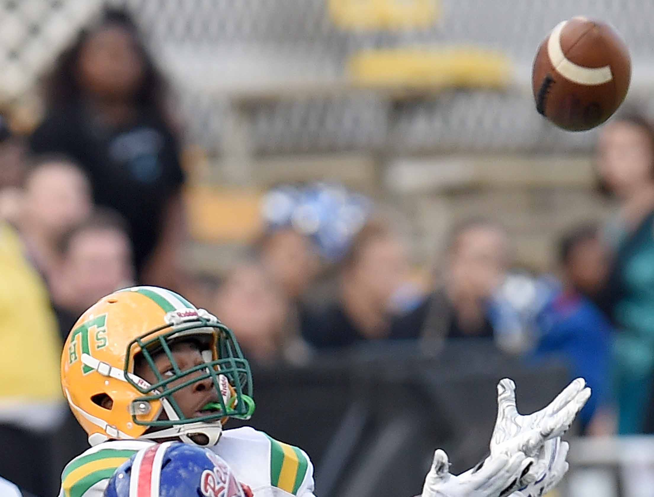 Taylorsville's Jalon Clark tries to catch a long pass over Scott Central's Dillon Shaw (3) on Saturday, December 1, 2018, in the MHSAA BlueCross BlueShield Gridiron Classic High School Football Championships in M.M. Roberts Stadium on the University of Southern Mississippi campus in Hattiesburg, Miss.