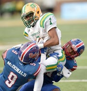 Taylorsville's Jabez Griffith (1) is tackled by two Scott Central defenders on Saturday, December 1, 2018, in the MHSAA BlueCross BlueShield Gridiron Classic High School Football Championships in M.M. Roberts Stadium on the University of Southern Mississippi campus in Hattiesburg, Miss.