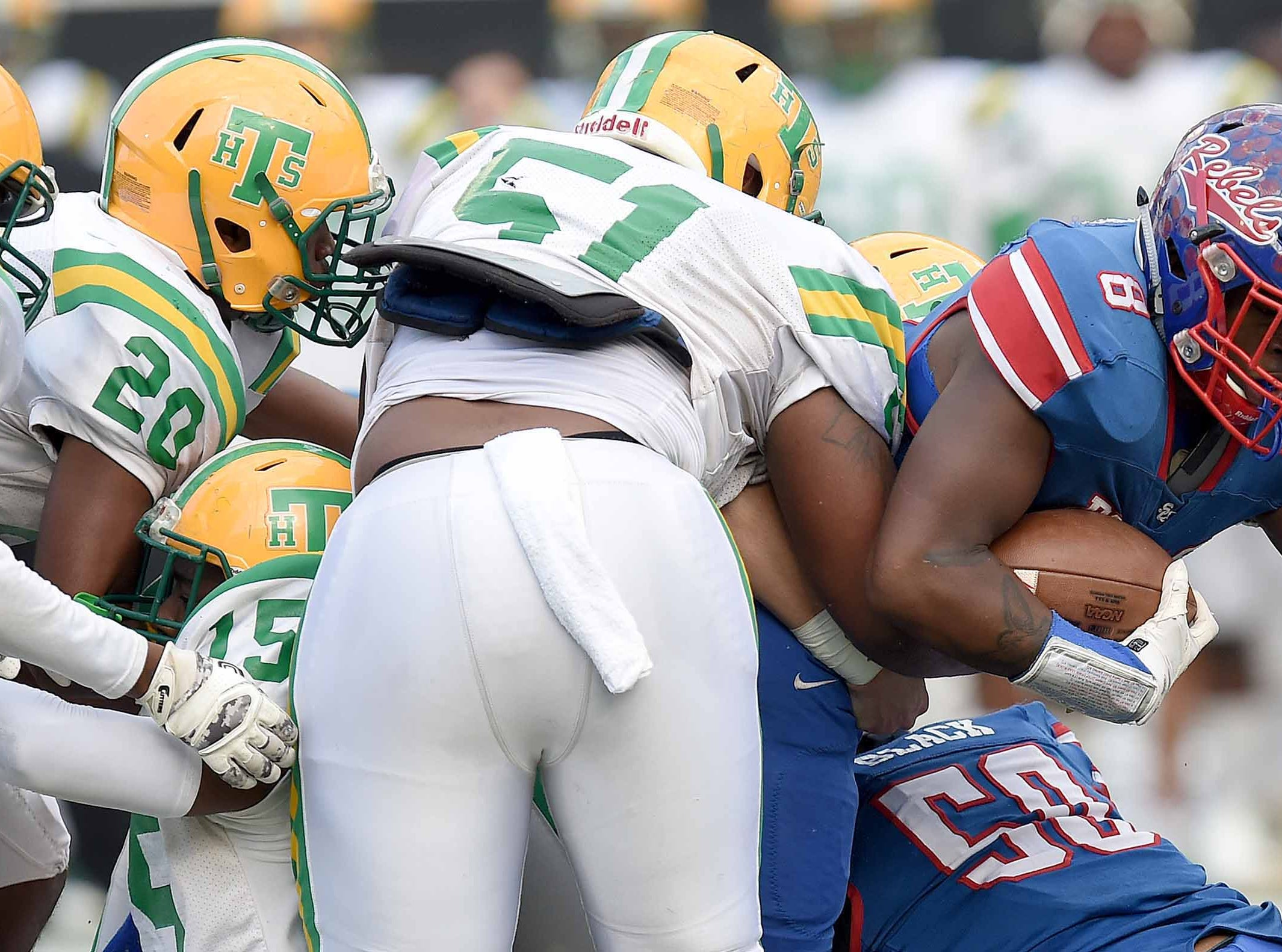 Scott Central's Nevonteque Strong (8) tries find a way through a wall of Taylorsville defenders on Saturday, December 1, 2018, in the MHSAA BlueCross BlueShield Gridiron Classic High School Football Championships in M.M. Roberts Stadium on the University of Southern Mississippi campus in Hattiesburg, Miss.