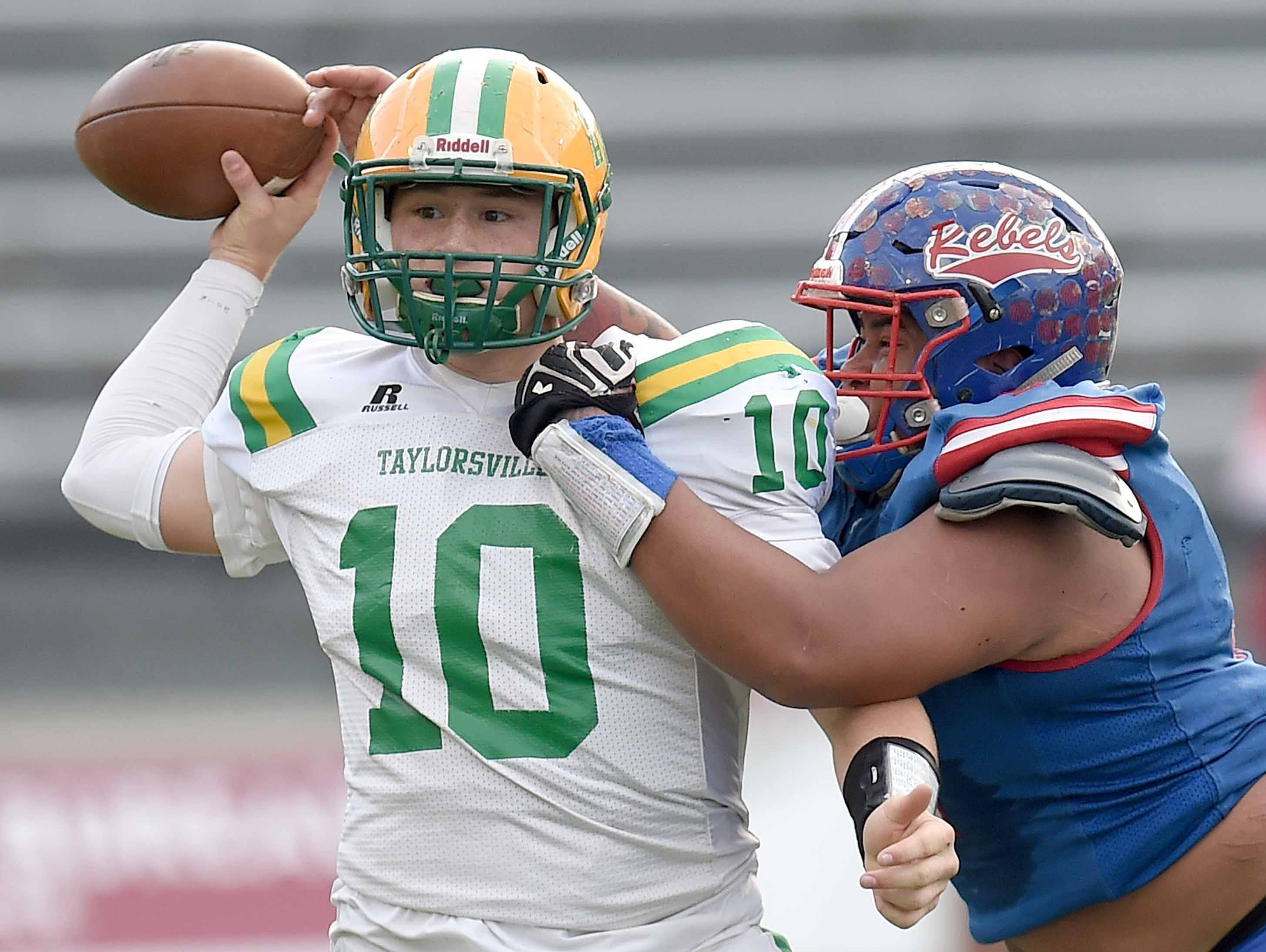 Taylorsville's Karson Evans (10) has his pass attempt disrupted by Scott Central's Hydee Barlow (4) on Saturday, December 1, 2018, in the MHSAA BlueCross BlueShield Gridiron Classic High School Football Championships in M.M. Roberts Stadium on the University of Southern Mississippi campus in Hattiesburg, Miss.