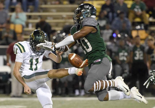 West Point's Ryan Melton (10) blocks the punt of West Jones' Walker Thompson (11) on Saturday, December 1, 2018, in the MHSAA BlueCross BlueShield Gridiron Classic High School Football Championships in M.M. Roberts Stadium on the University of Southern Mississippi campus in Hattiesburg, Miss.