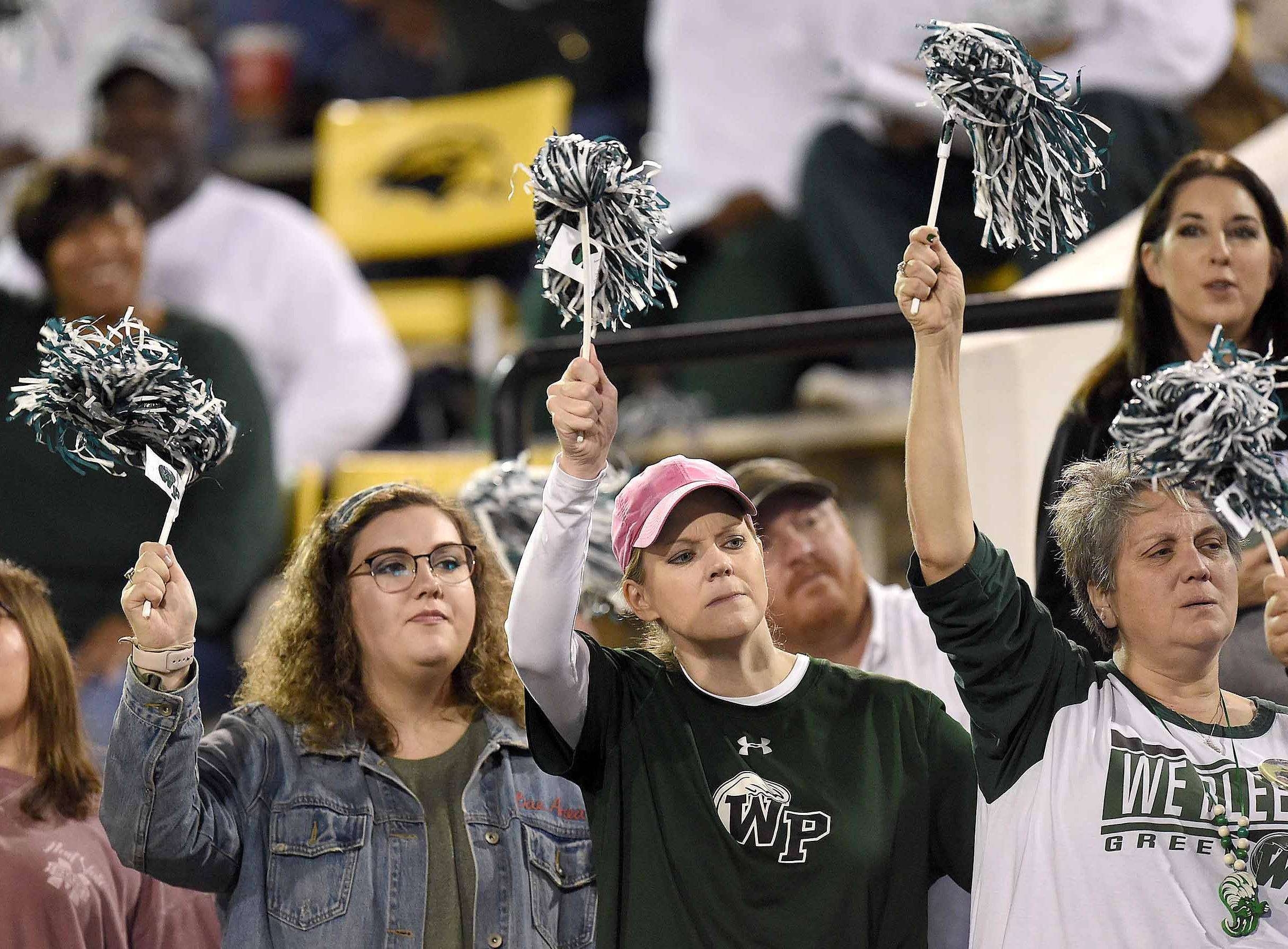 West Point fans cheer for the Green Wave on Saturday, December 1, 2018, in the MHSAA BlueCross BlueShield Gridiron Classic High School Football Championships in M.M. Roberts Stadium on the University of Southern Mississippi campus in Hattiesburg, Miss.