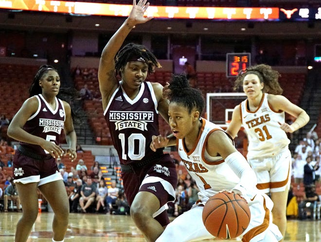 Mississippi State senior point guard Jazzmun Holmesdefends Texas guard Sug Sutton during the No. 6 Bulldogs' 67-49 win over No. 10 Texas. Holmes had a career-high 17 points.