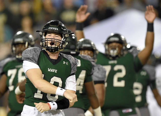The West Point Green Wave offense, led by quarterback Jake Chambless (18) celebrate a touchdown against West Jones on Saturday, December 1, 2018, in the MHSAA BlueCross BlueShield Gridiron Classic High School Football Championships in M.M. Roberts Stadium on the University of Southern Mississippi campus in Hattiesburg, Miss.