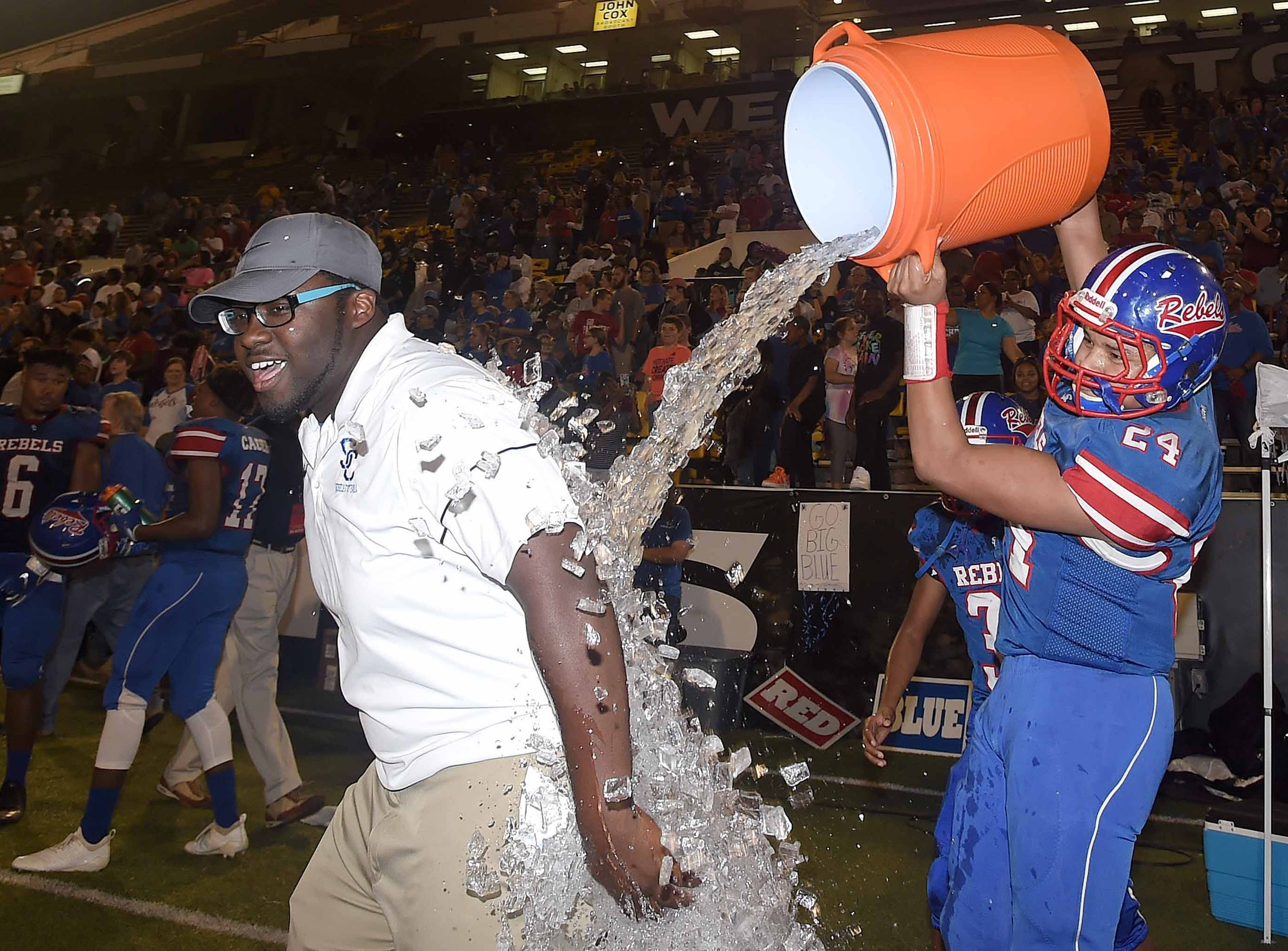 Scott Central's Zechariah Parodi (24) give a coach an ice water bath on Saturday, December 1, 2018, in the MHSAA BlueCross BlueShield Gridiron Classic High School Football Championships in M.M. Roberts Stadium on the University of Southern Mississippi campus in Hattiesburg, Miss.