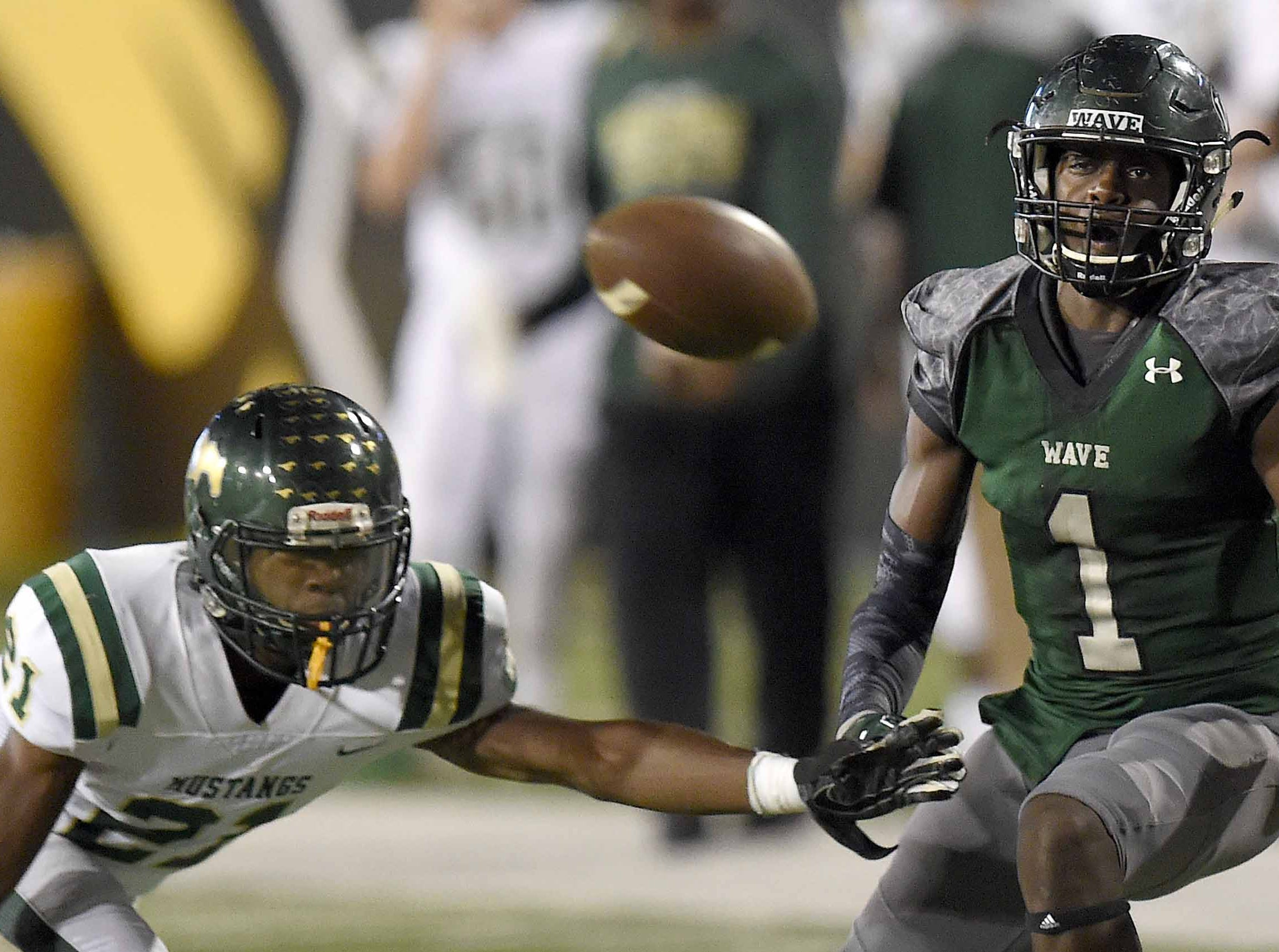 West Jones' Cedric Bender (21) breaks up a pass to West Point's Jacquerius Crawford (1) on Saturday, December 1, 2018, in the MHSAA BlueCross BlueShield Gridiron Classic High School Football Championships in M.M. Roberts Stadium on the University of Southern Mississippi campus in Hattiesburg, Miss.