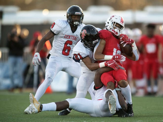 Henry County's Ethan Thompson (16) is taken down by the Knoxville Central defense in the Class 5A final Sunday at Tucker Stadium.