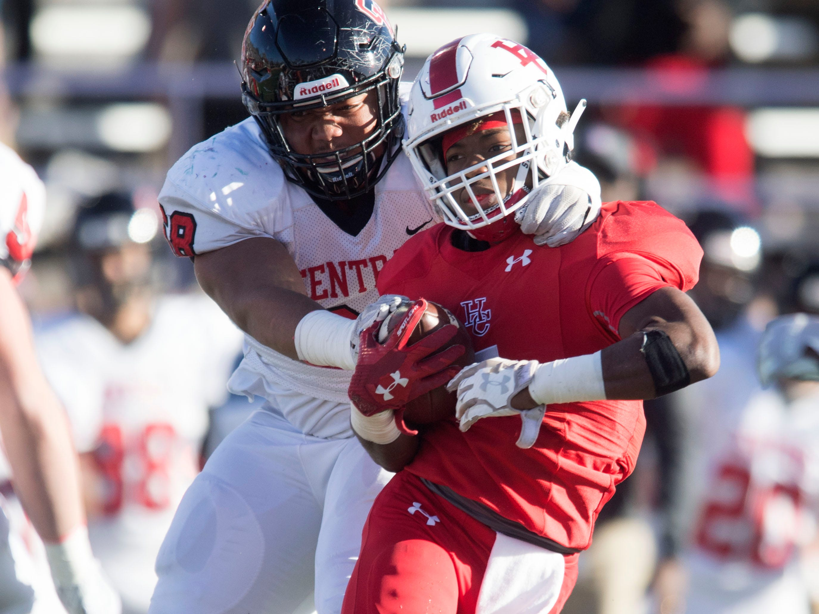 Henry County's  Mekhi Sanders (47)  is grabbed by Knoxville Central's Jakobi Troutman (68) in the Class 5A BlueCross Bowl at Tucker Stadium on Sunday, December 2, 2018.