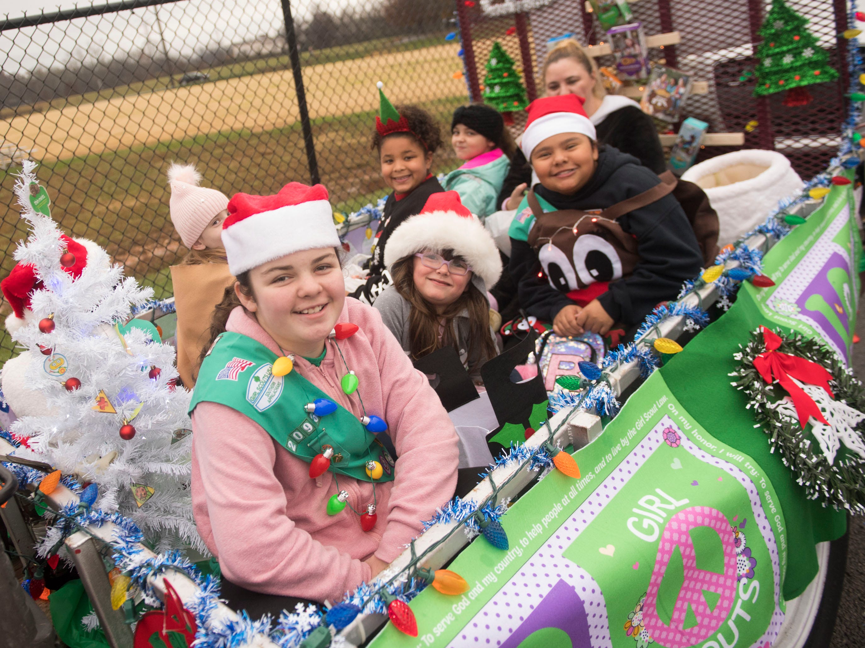 Girl Scouts Troop 20960 is ready on their float for the Powell Lions Club Christmas Parade on Saturday, December 1, 2018.