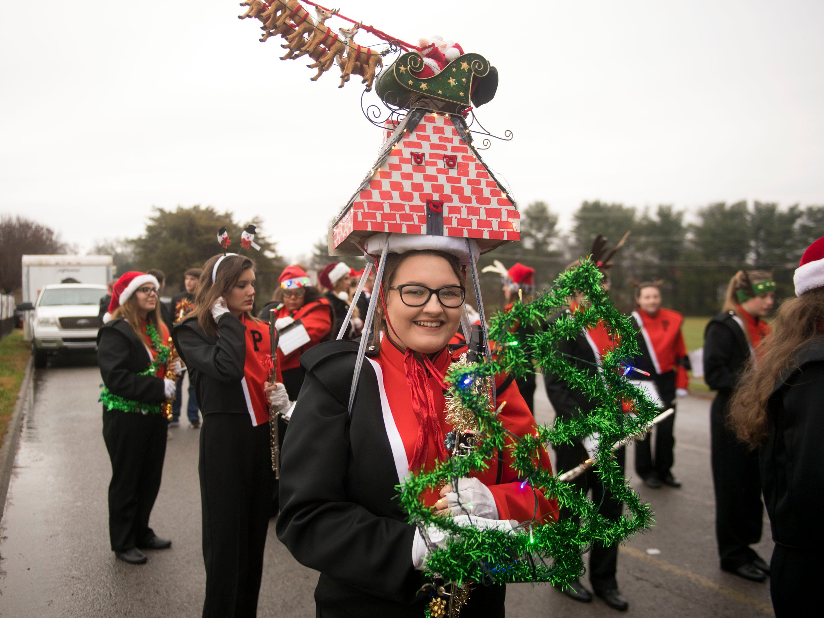Powell High School Marching Panther Band member Hannah Parker is decorated for the Powell Lions Club Christmas Parade on Saturday, December 1, 2018.