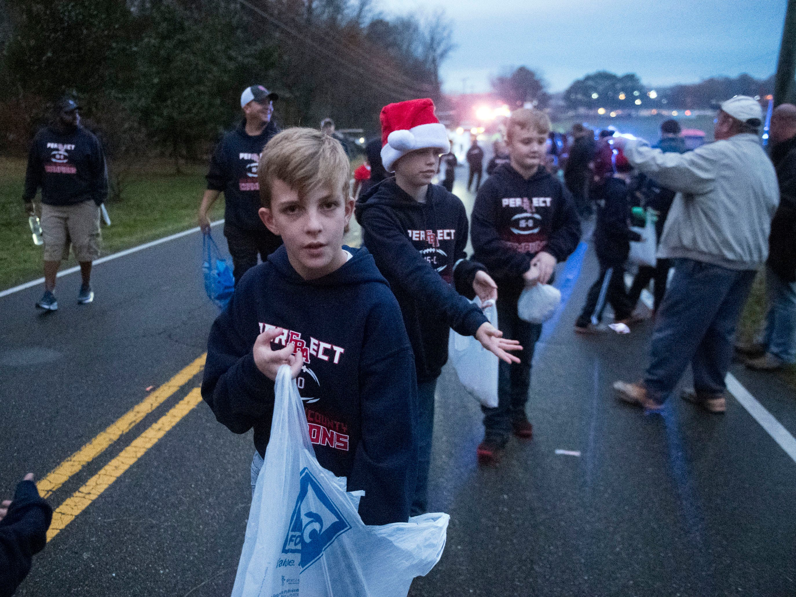 Parade participants hand out candy in the Powell Lions Club Christmas Parade on Saturday, December 1, 2018.