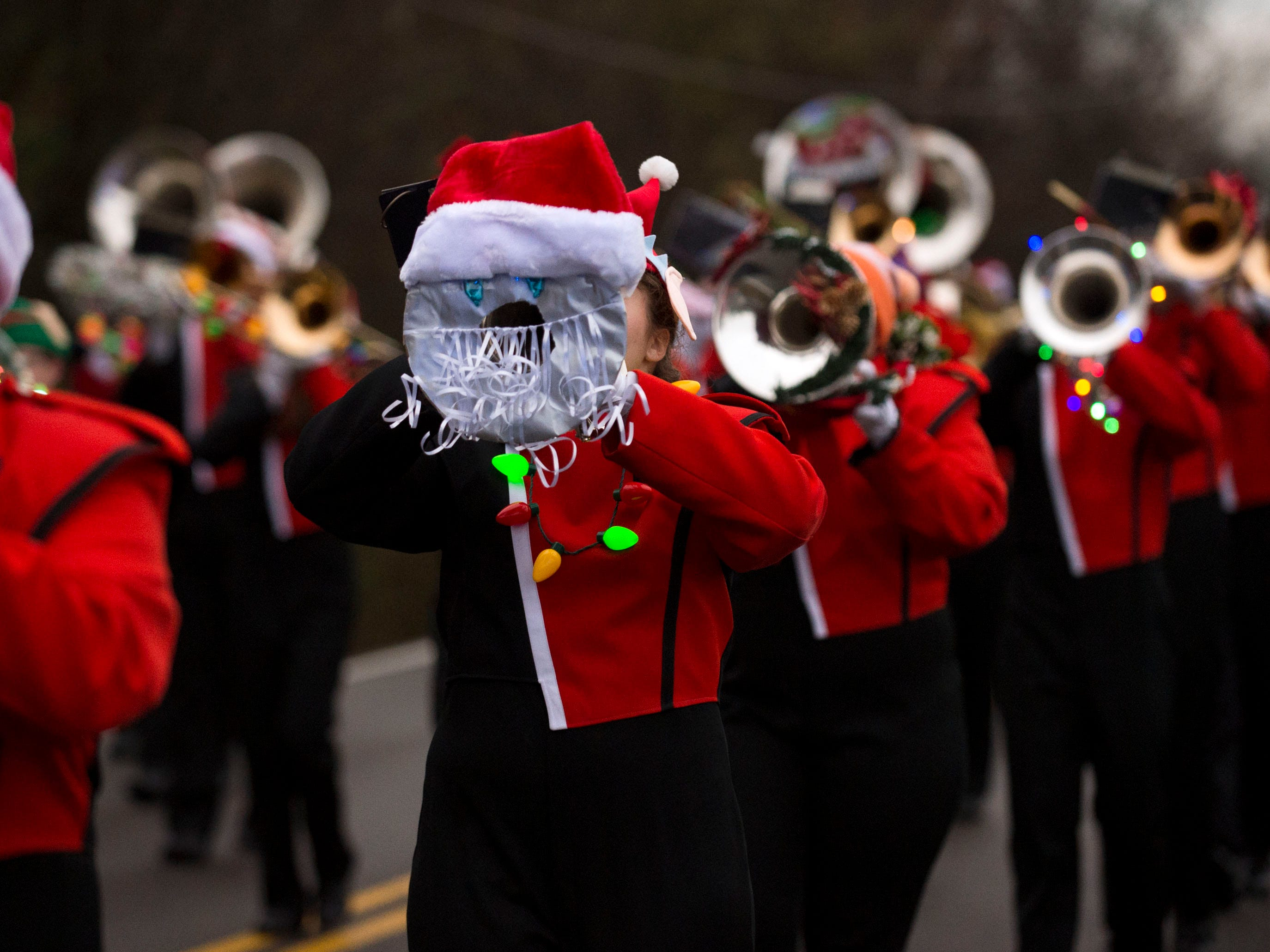 The Powell High School Marching Panther Band performing in the Powell Lions Club Christmas Parade on Saturday, December 1, 2018.