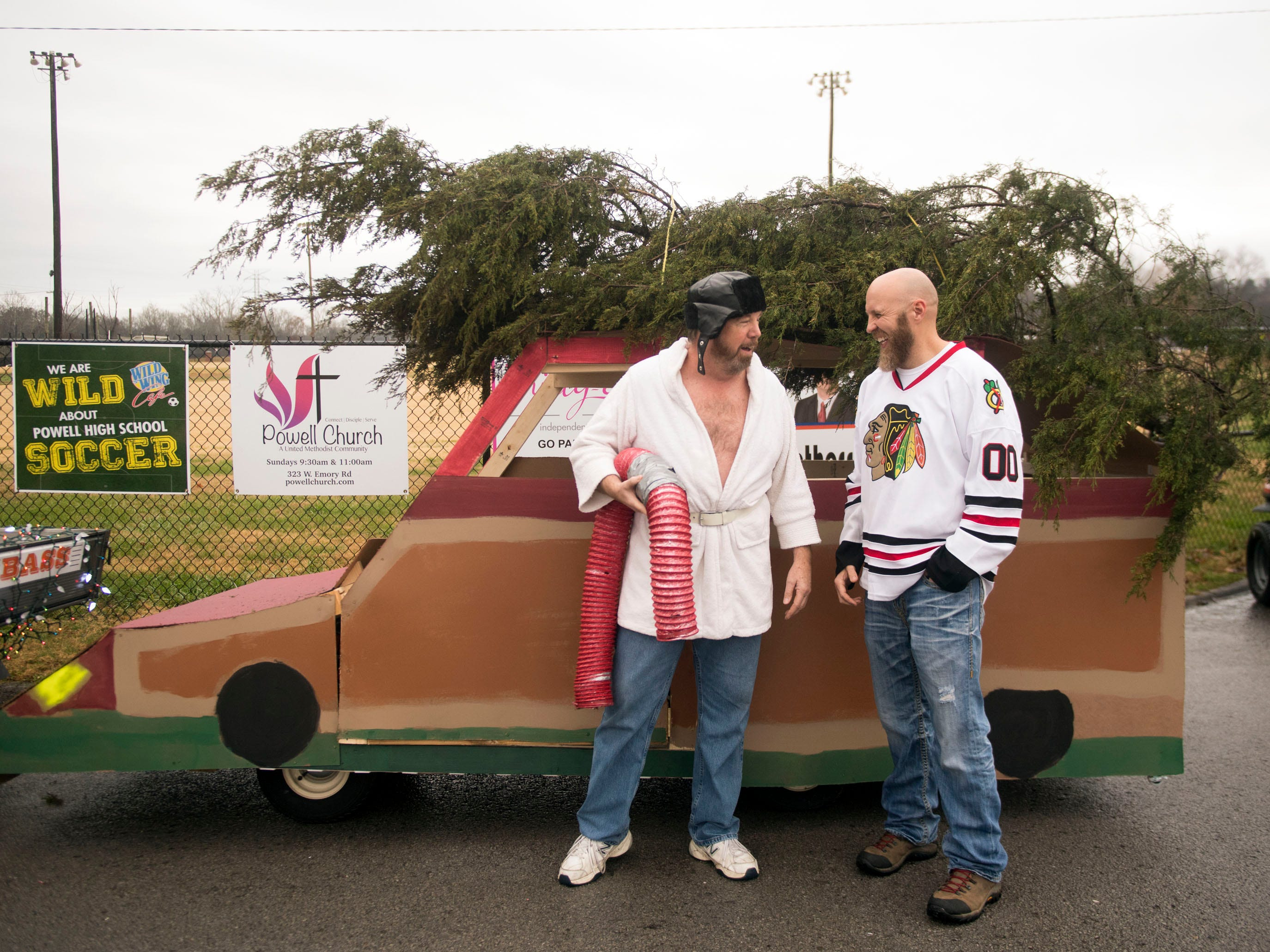 """Powell High School band parents Roy Wright and Whitney Hammond are dressed as Cousin Eddie and Clark Griswold from the the movie """"Christmas Vacation"""" for the Powell Lions Club Christmas Parade on Saturday, December 1, 2018."""