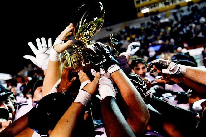 Alcoa celebrates with the trophy after their 21-14 win during a game between Alcoa and Covington at the TSSAA Blue Cross Bowl at Tennessee Tech's Tucker Stadium in Cookeville, Tennessee on Saturday, December 1, 2018.