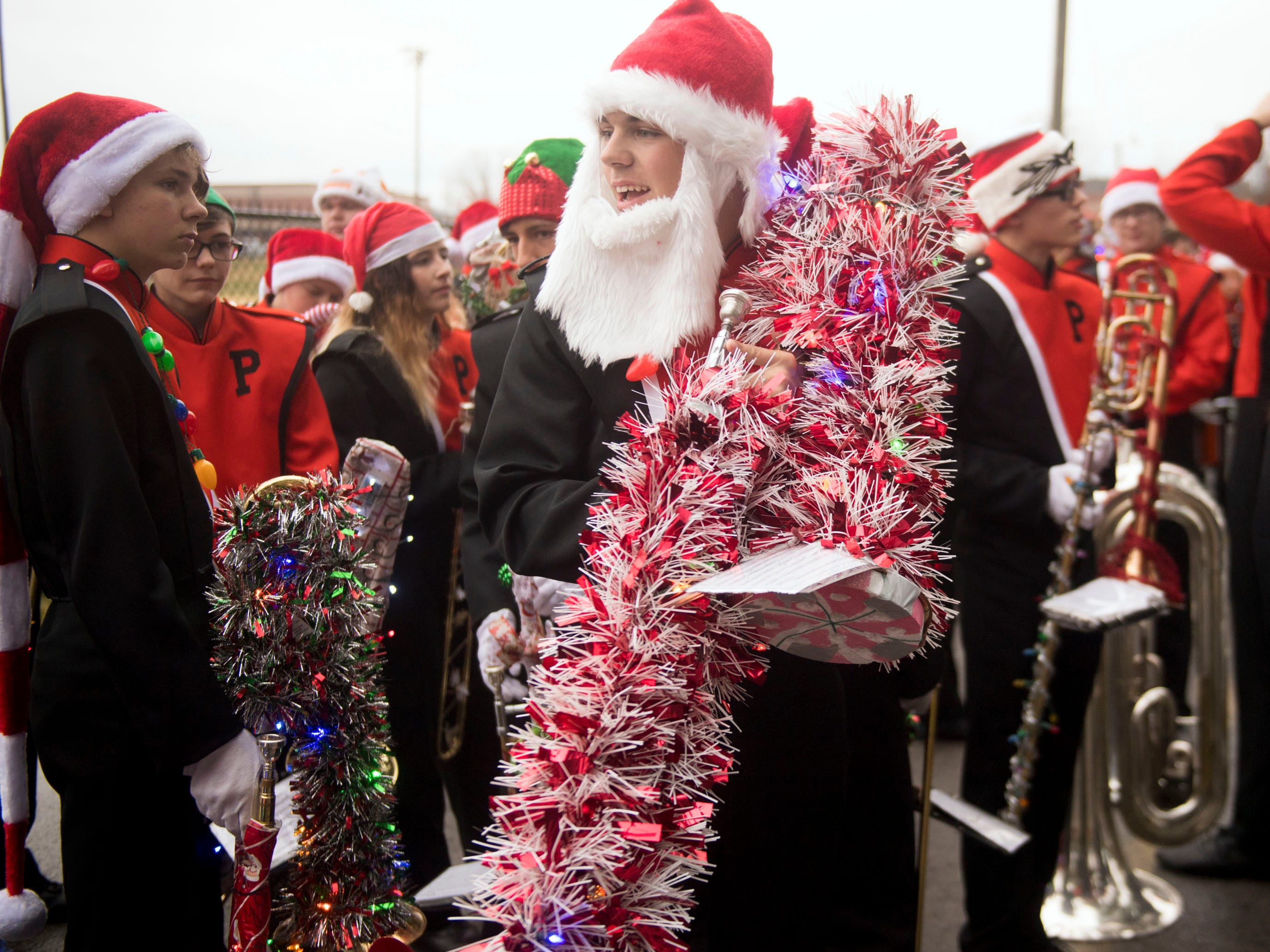 Members for the Powell High School Marching Panther Band are ready for the Powell Lions Club Christmas Parade on Saturday, December 1, 2018e