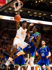 Tennessee forward Kyle Alexander (11) hangs off the rim after dunking the ball during the second half of the Tennessee Volunteers' home basketball game against the Texas A&M-Corpus Christi Islanders at Thompson-Boling Arena on Sunday, December 2, 2018.