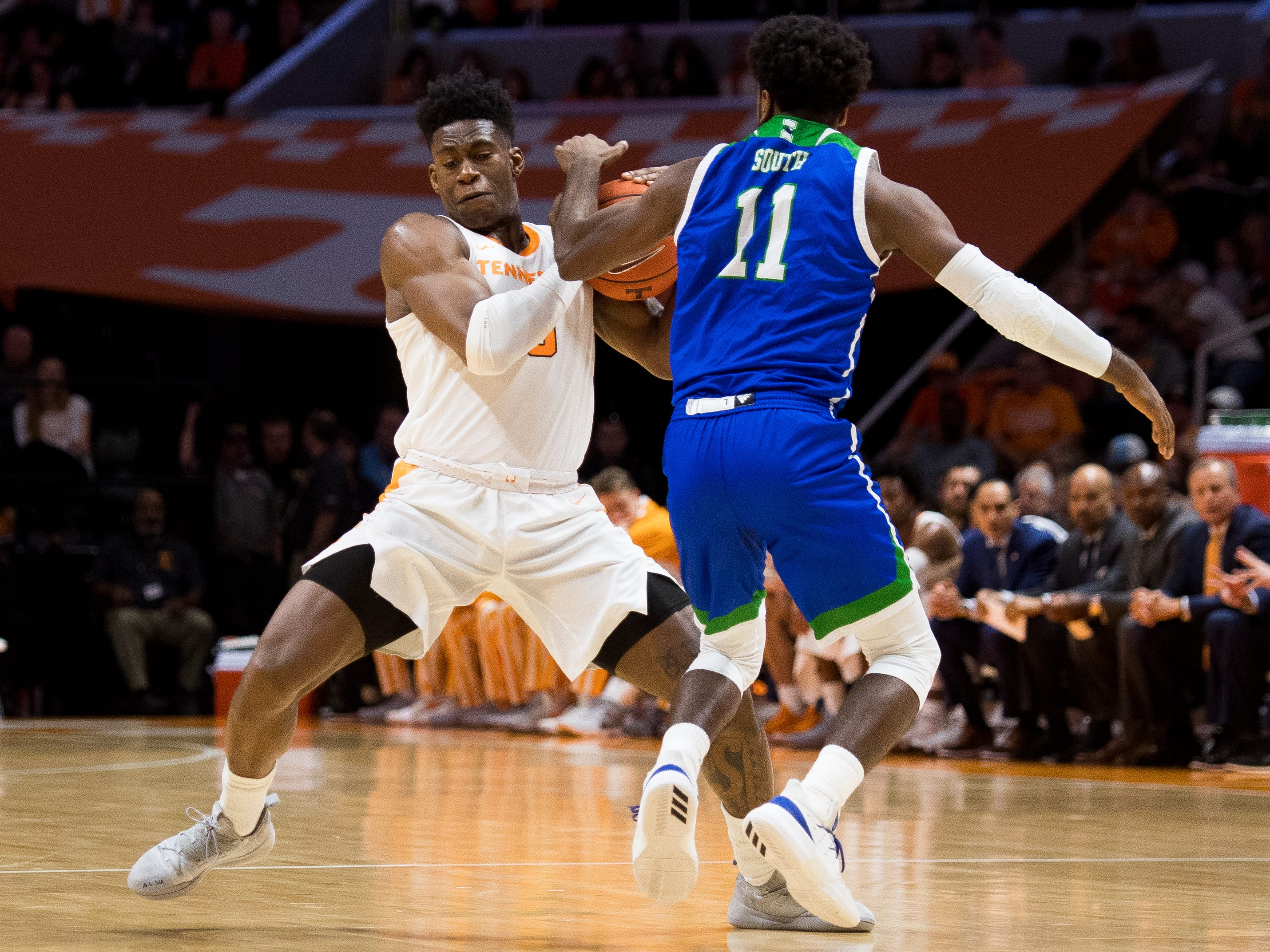 Tennessee guard Admiral Schofield (5) steals the ball away from Texas A&M-Corpus Christi guard Kareem South (11) during the first half of the Tennessee Volunteers' home basketball game against the Texas A&M-Corpus Christi Islanders at Thompson-Boling Arena on Sunday, December 2, 2018.