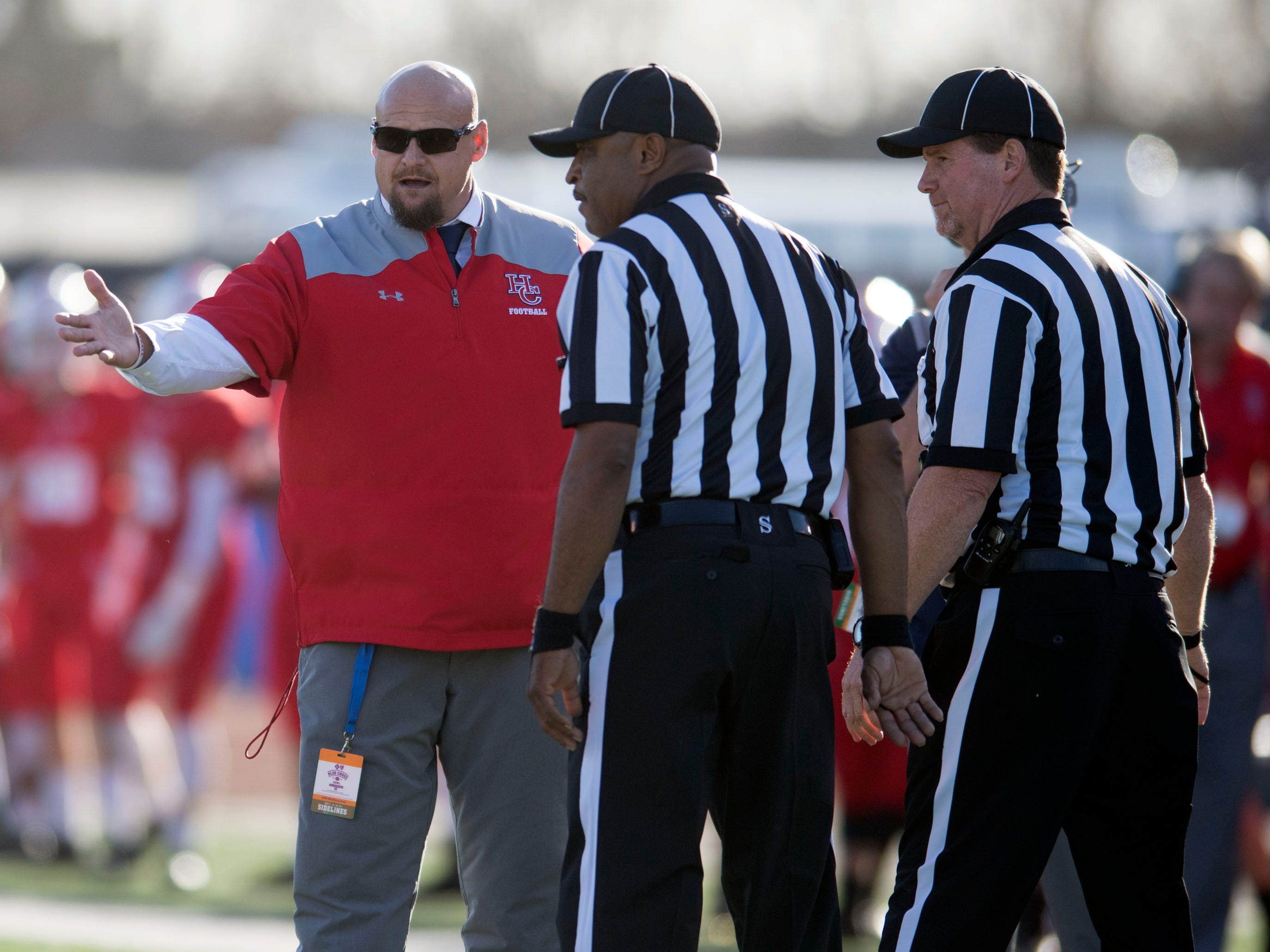 Henry County head coach James Counce Jr. talks with officials during the Class 5A BlueCross Bowl with Knoxville Central at Tucker Stadium on Sunday, December 2, 2018.