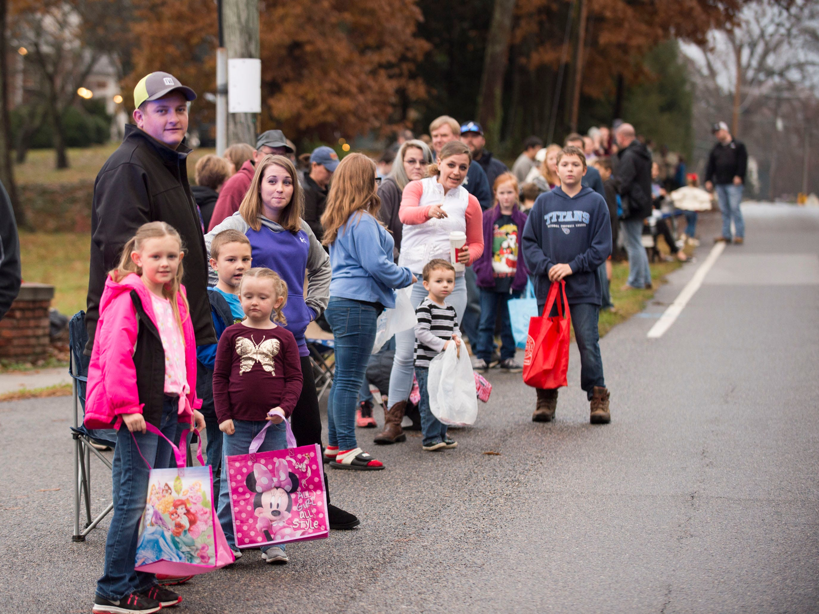The Powell community lines up along Emory Road for the  Powell Lions Club Christmas Parade on Saturday, December 1, 2018.
