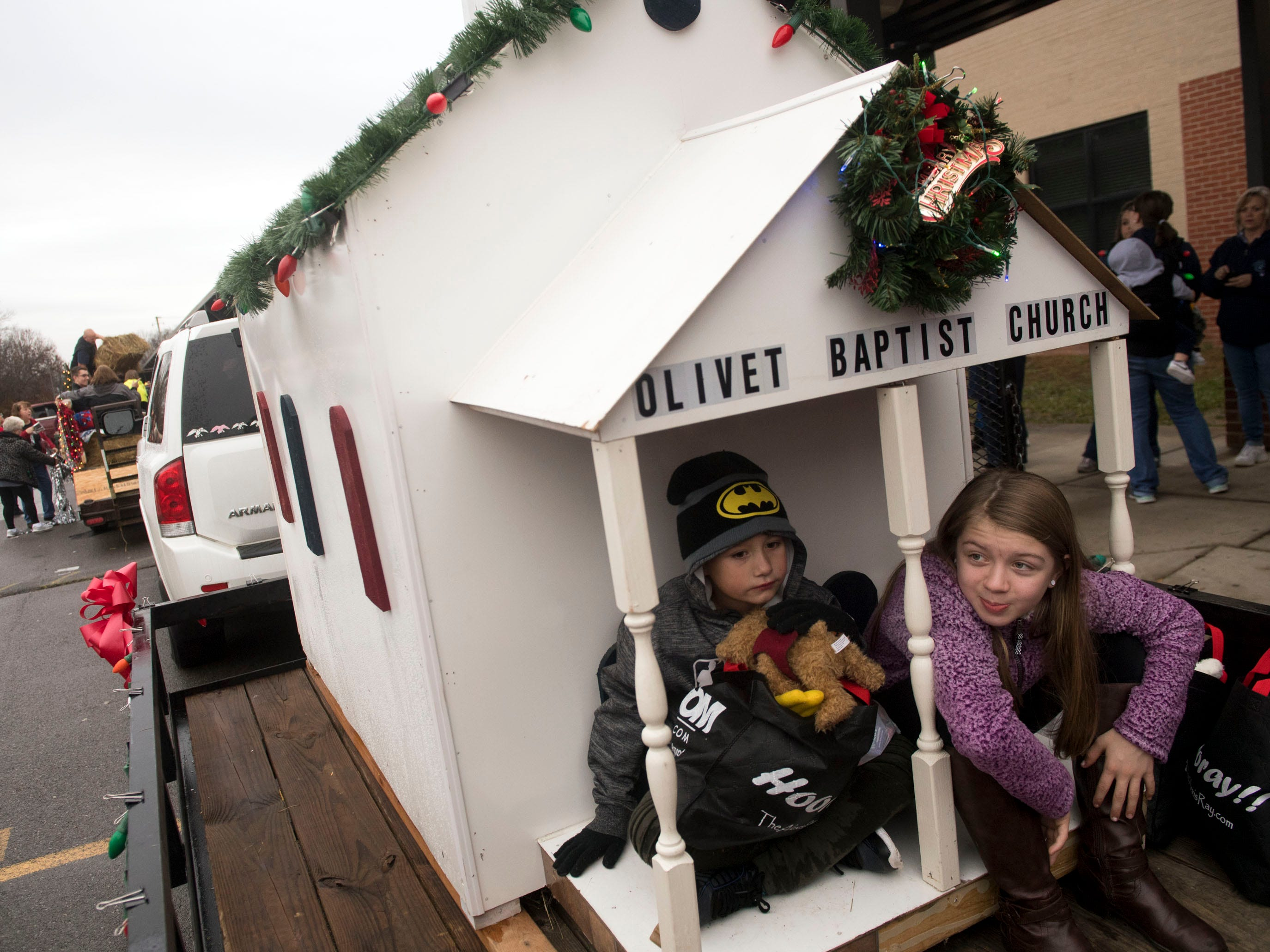 Braylan Perry and Addy Caldwell sit on the back of the Olivet Baptist Church float the the Powell Lions Club Christmas Parade on Saturday, December 1, 2018.