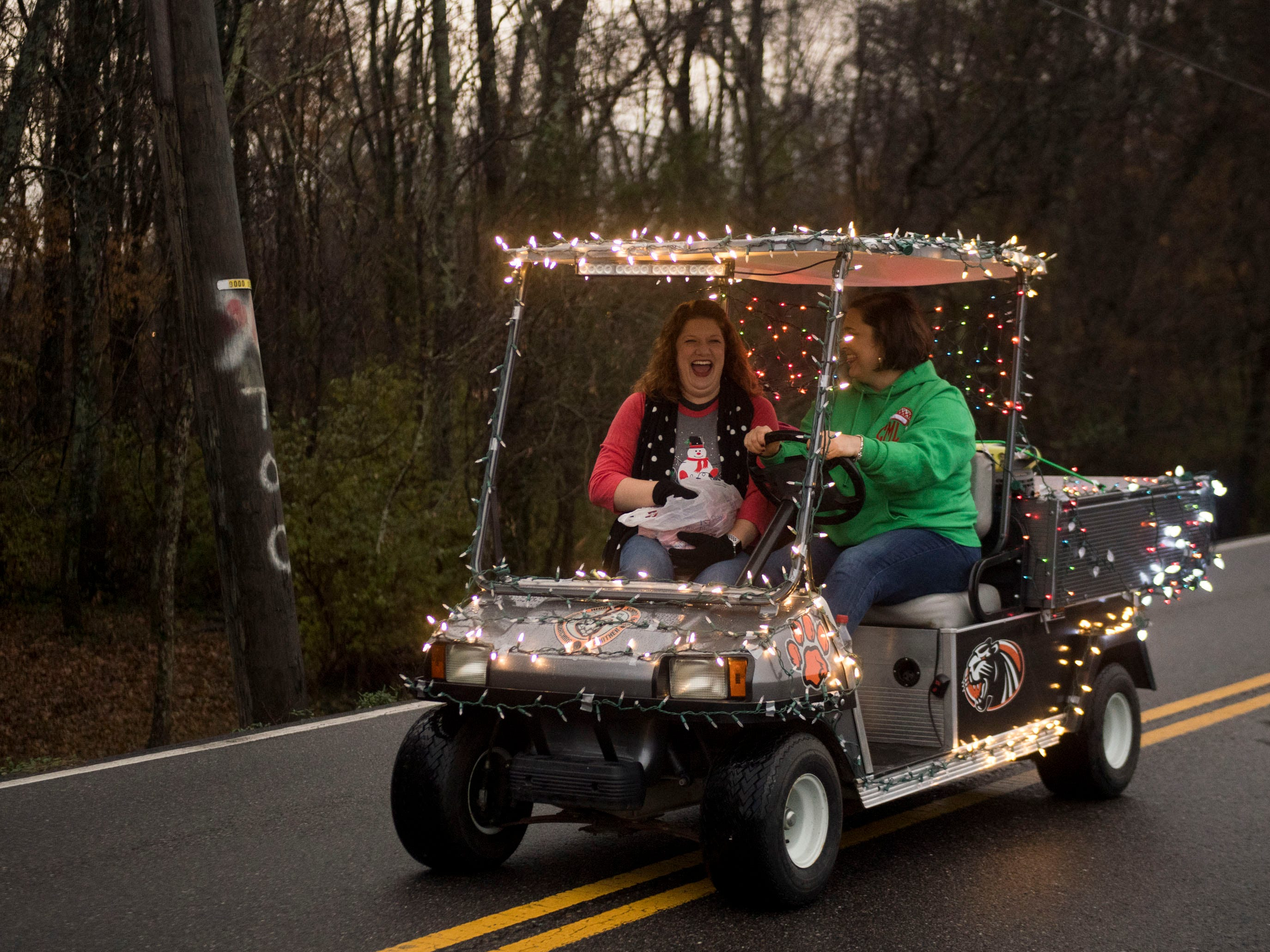 A well decorated cart follows the Powell High School Marching Panther Band members in the Powell Lions Club Christmas Parade on Saturday, December 1, 2018.