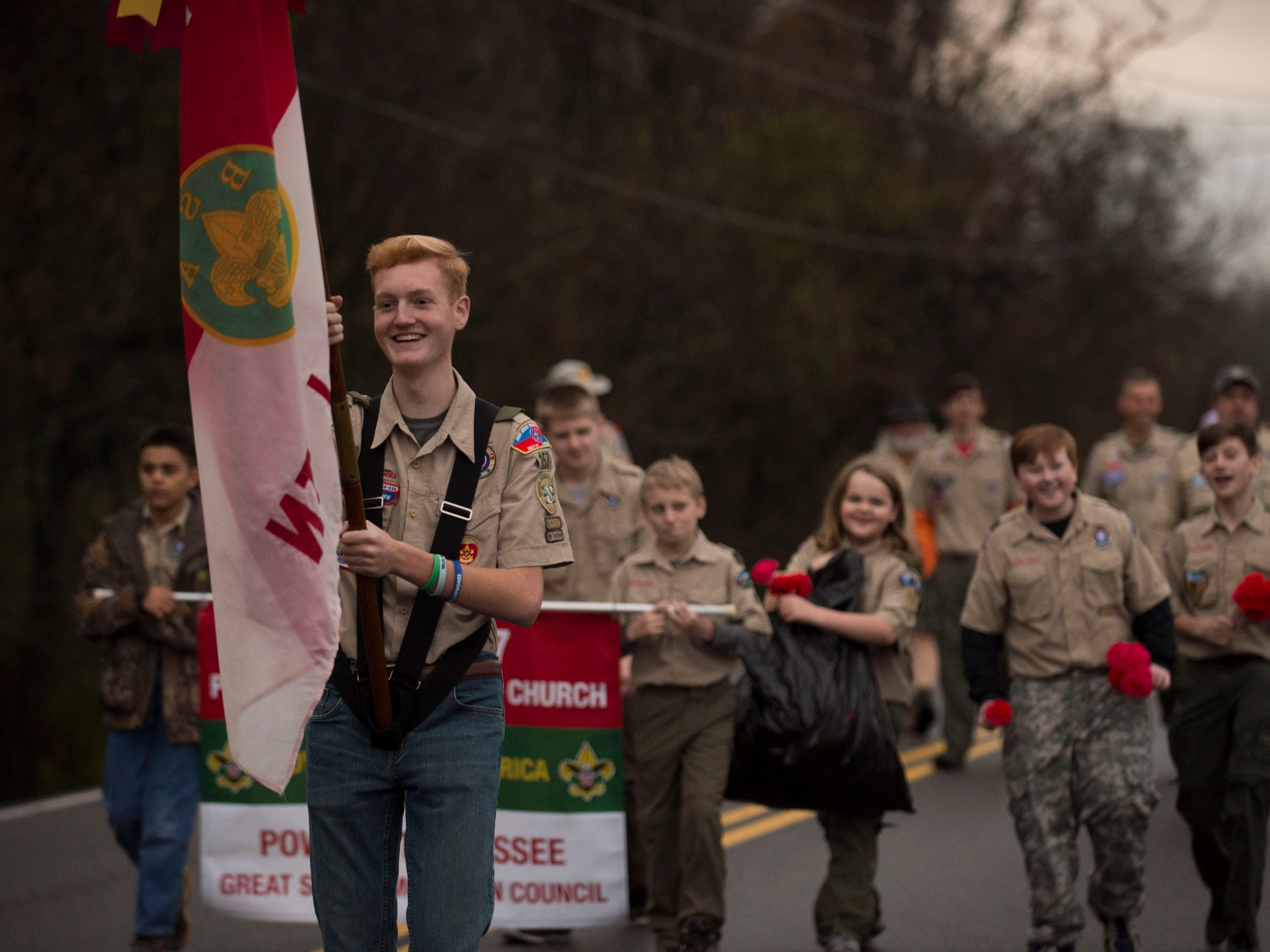 Boy Scout Troop 157 leads the Powell Lions Club Christmas Parade on Saturday, December 1, 2018.