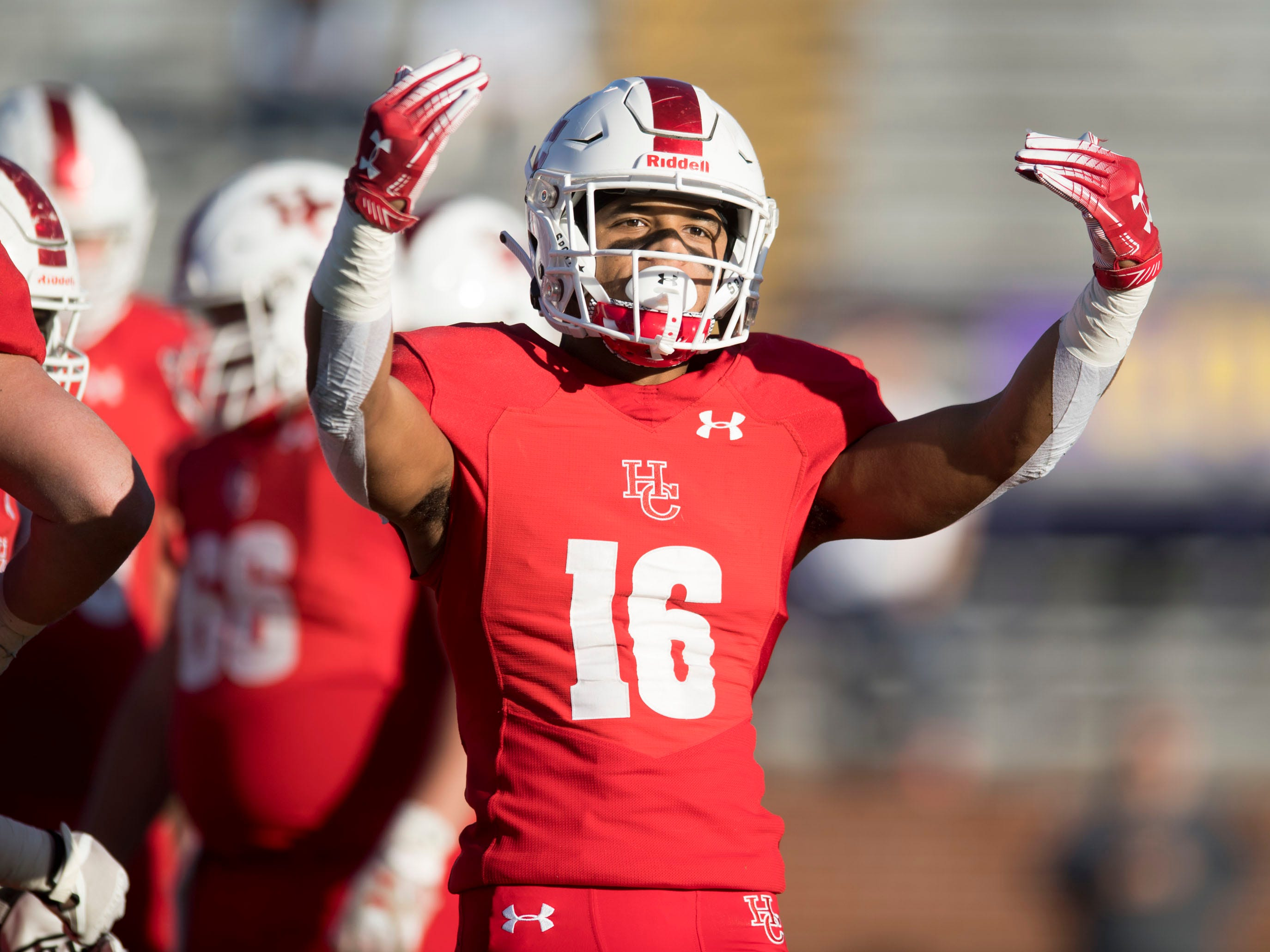 Henry County's Ethan Thompson (16) encourages Henry County fans during the game against Knoxville Central in the Class 5A BlueCross Bowl at Tucker Stadium on Sunday, December 2, 2018.