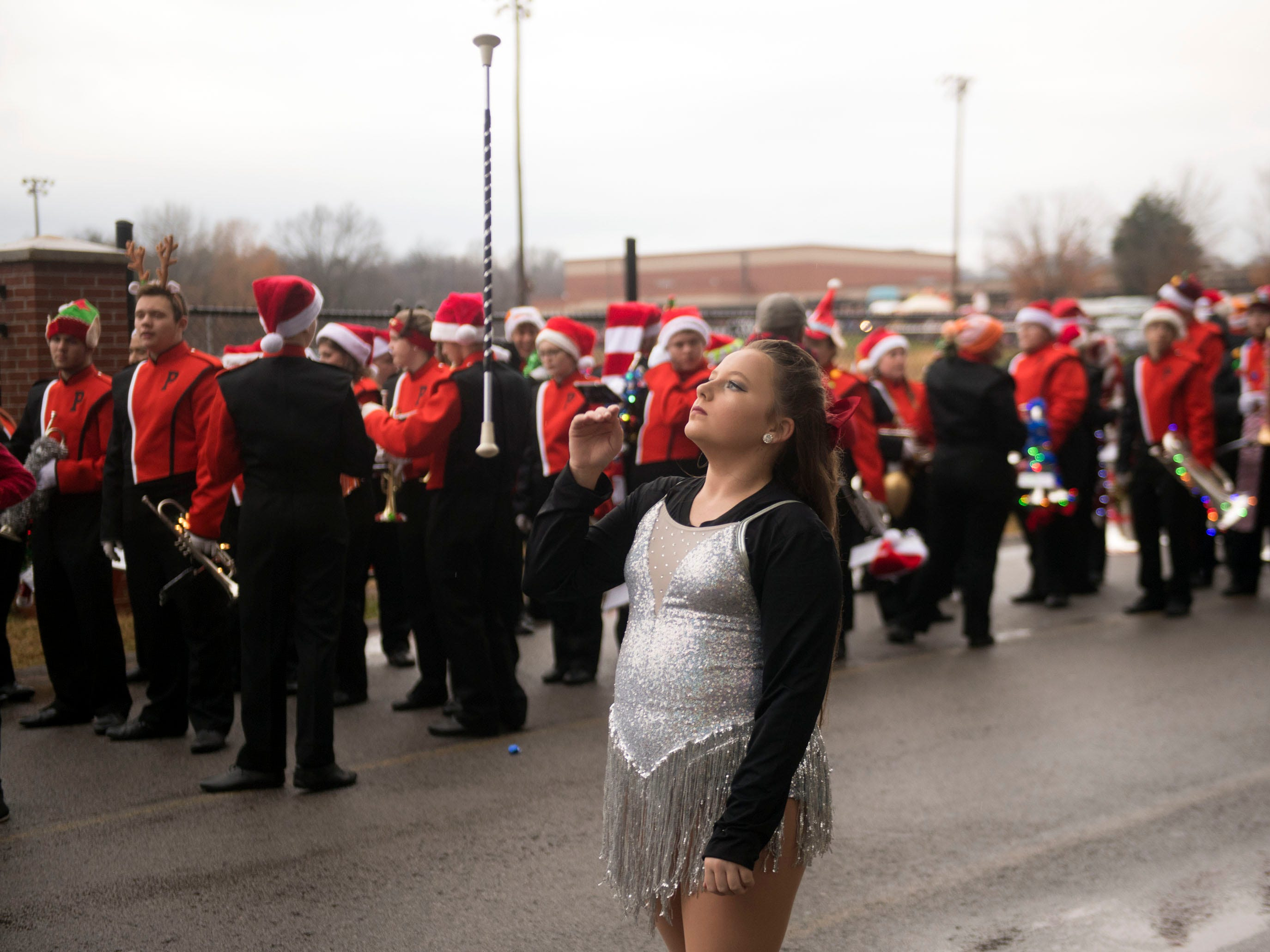 Felicia Hawk of the Powell High School Marching Panther Band warms up before the start of the Powell Lions Club Christmas Parade on Saturday, December 1, 2018.