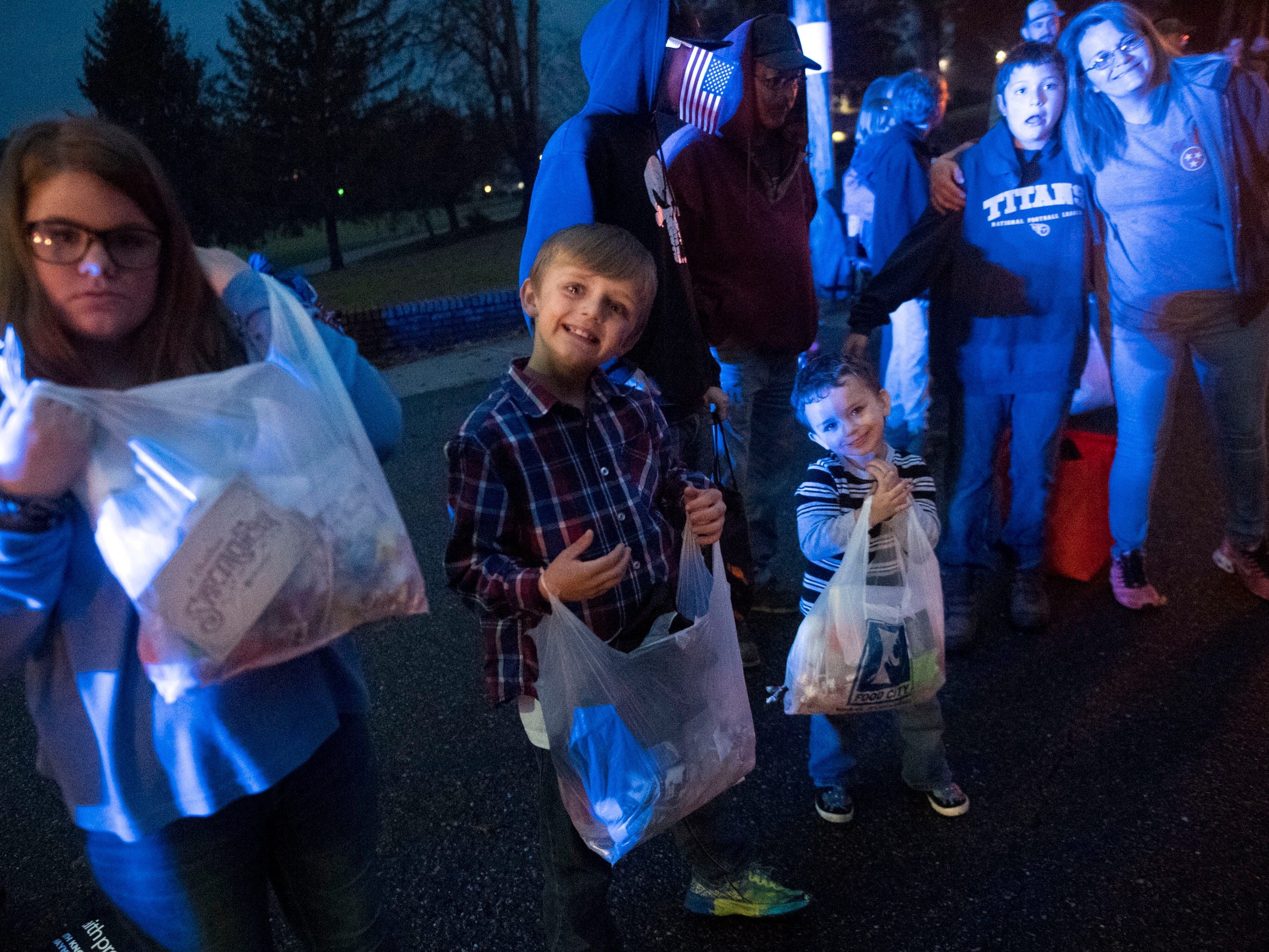 Children wait for candy during the the Powell Lions Club Christmas Parade on Saturday, December 1, 2018.