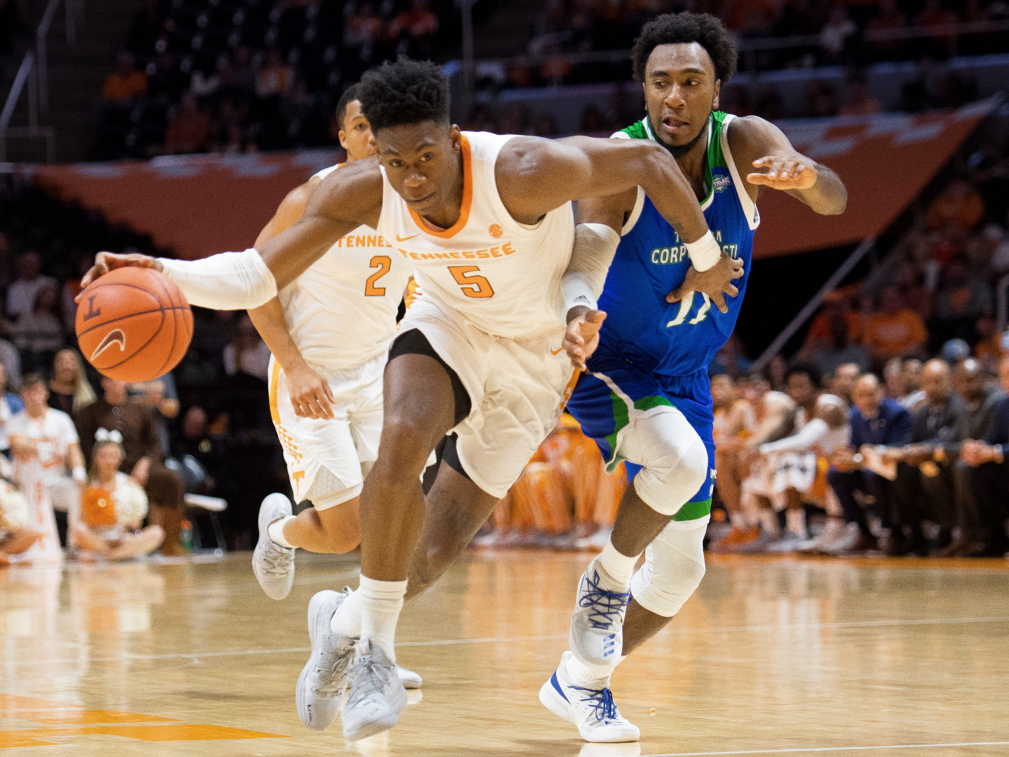 Tennessee guard Admiral Schofield (5) drives down the court after stealing the ball away from Texas A&M-Corpus Christi guard Kareem South (11) during the first half of the Tennessee Volunteers' home basketball game against the Texas A&M-Corpus Christi Islanders at Thompson-Boling Arena on Sunday, December 2, 2018.