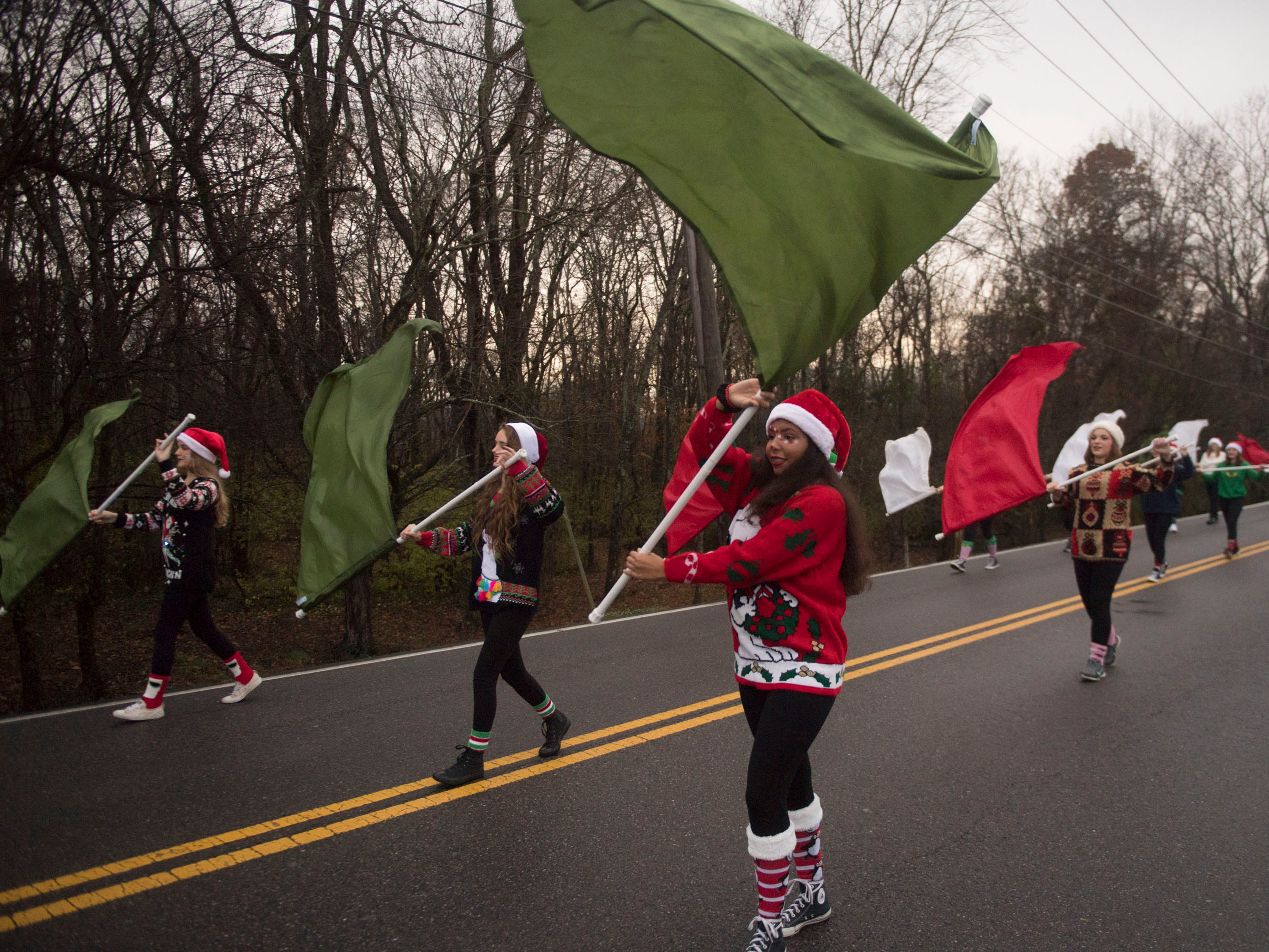 The Powell High School Marching Panther Band Color Guard participating in the Powell Lions Club Christmas Parade on Saturday, December 1, 2018.