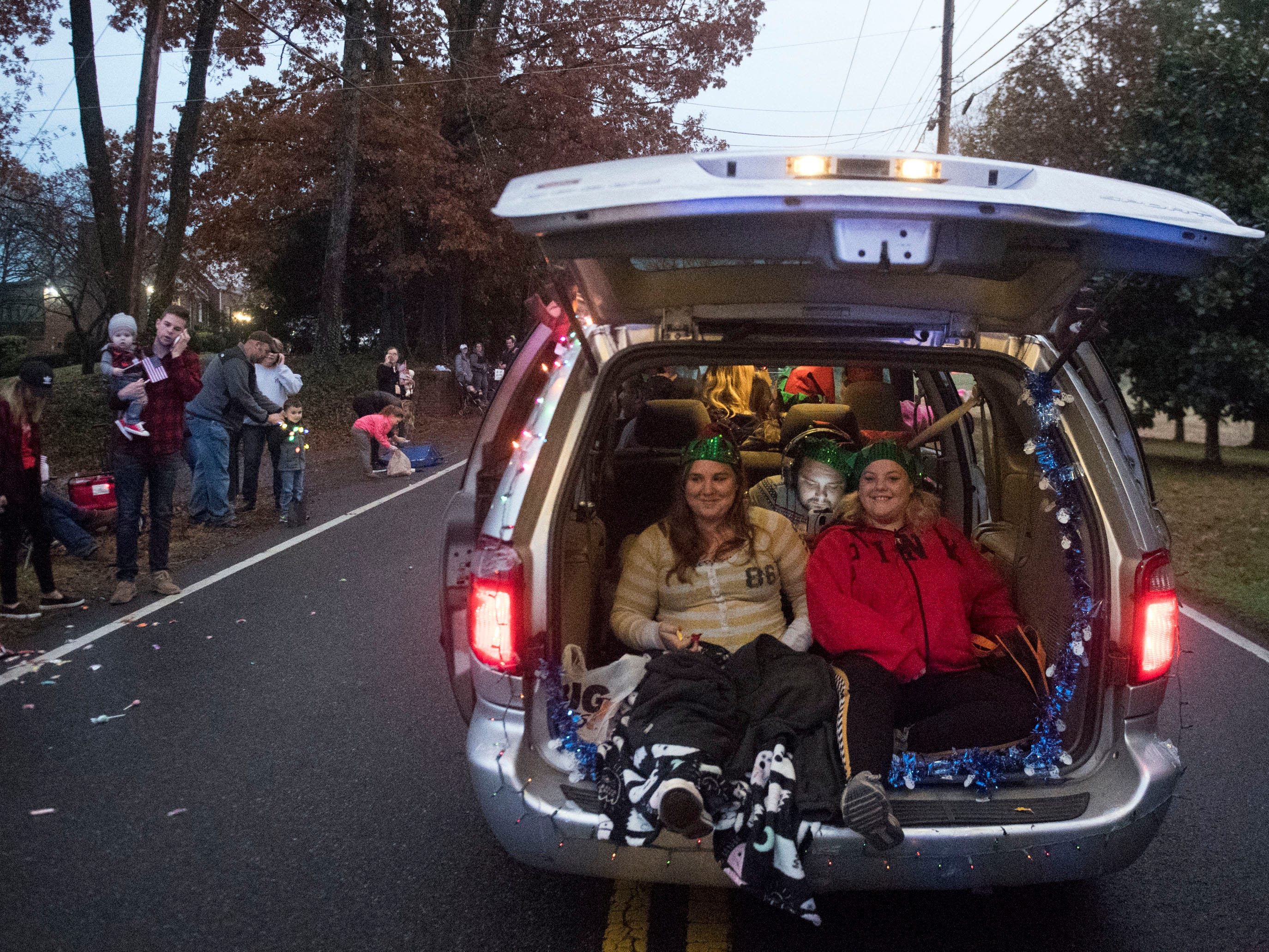 Powell Lions Club Christmas Parade participants throw candy from the back of a van on Saturday, December 1, 2018.