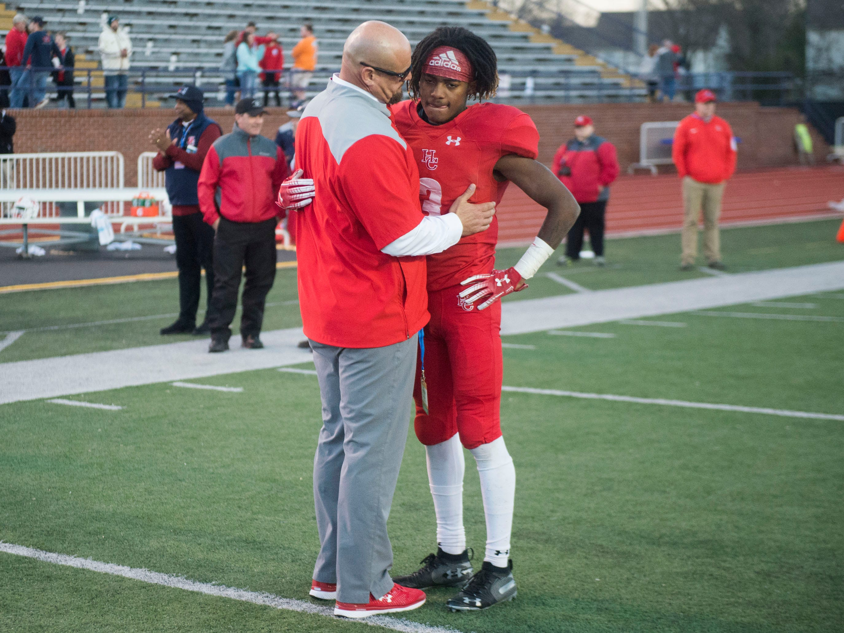 Henry County Football Coach James Counce Jr. talks with Tavion Kendley (3) after the loss to Knoxville Central in the Class 5A BlueCross Bowl at Tucker Stadium on Sunday, December 2, 2018.