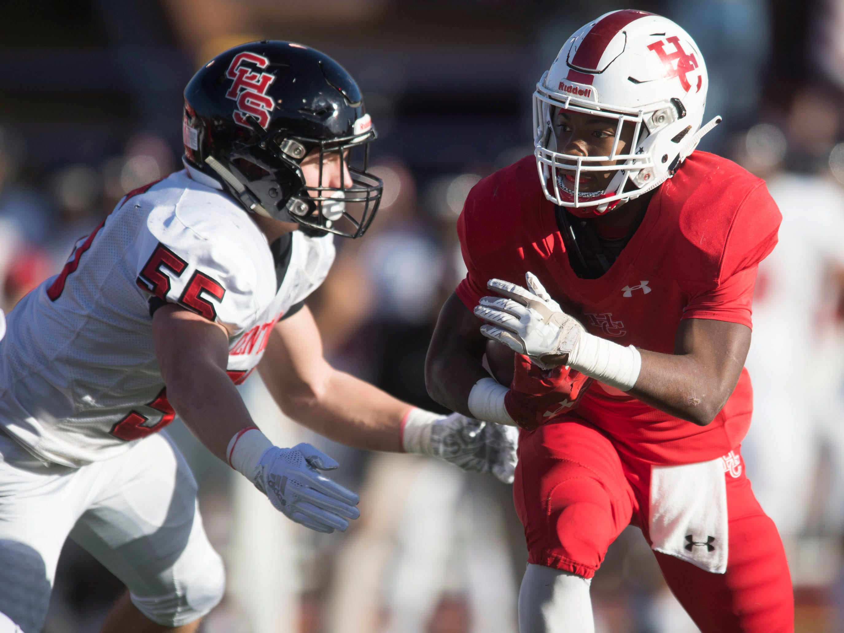 Henry County's Amarion Manzi (6) runs for yards while approached by Knoxville Central's Tyler Bost (55) in the Class 5A BlueCross Bowl at Tucker Stadium on Sunday, December 2, 2018.