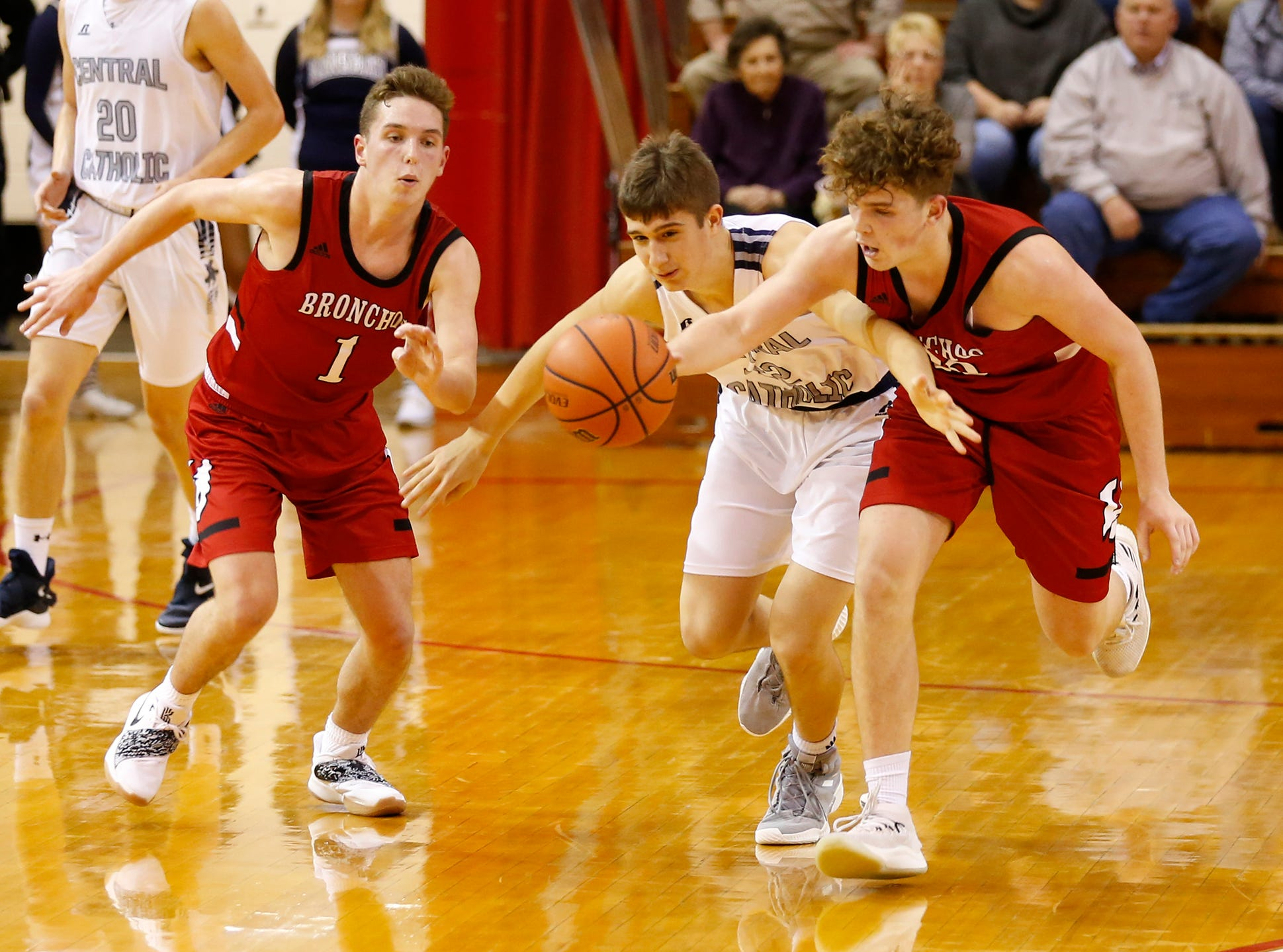 Brothers Avery, left, and Ashton Beaver of Lafayette Jeff combine to steal the ball from Clark Barrett of Central Catholic in the championship of the Franciscan Health Hoops Classic Saturday, December 1, 2018, at Lafayette Jeff. Jeff defeated Central Catholic 76-73 for the title.