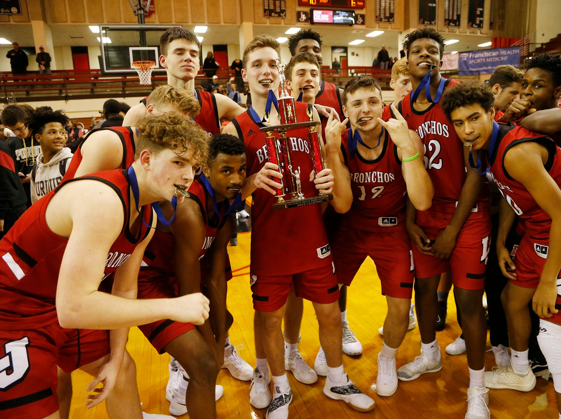 Lafayette Jeff players enjoy the spoils of victory after defeating Central Catholic 76-73 to win the championship of the Franciscan Health Hoops Classic Saturday, December 1, 2018, at Lafayette Jeff.