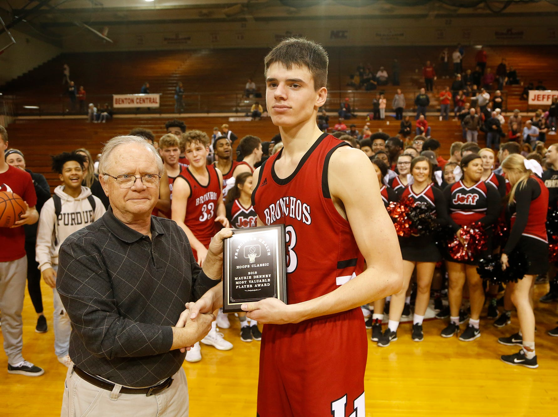 Brooks Barnhizer of Lafayette Jeff is preseneted the Maurie Denney Most Valuable Player Award following the championship of the Franciscan Health Hoops Classic Saturday, December 1, 2018, at Lafayette Jeff. Lafayette Jeff defeated Central Catholic 76-73 for the title.