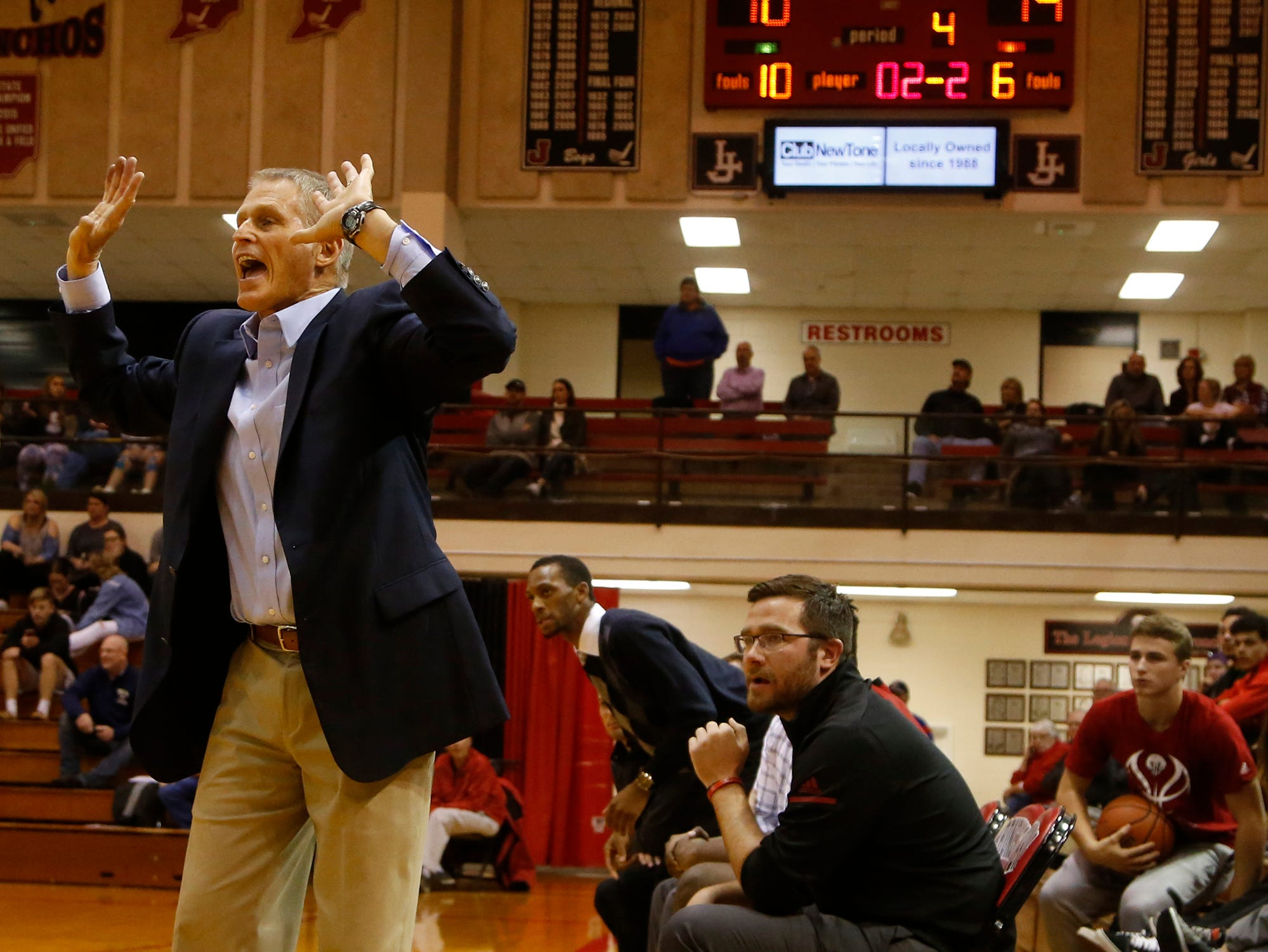 Lafayette Jeff head coach Mark Barnhizer shouts to the Bronchos as they lead Central Catholic by four points with just over 12 seconds remaining in the championship of the Franciscan Health Hoops Classic Saturday, December 1, 2018, at Lafayette Jeff. Jeff defeated Central Catholic 76-73 for the title.